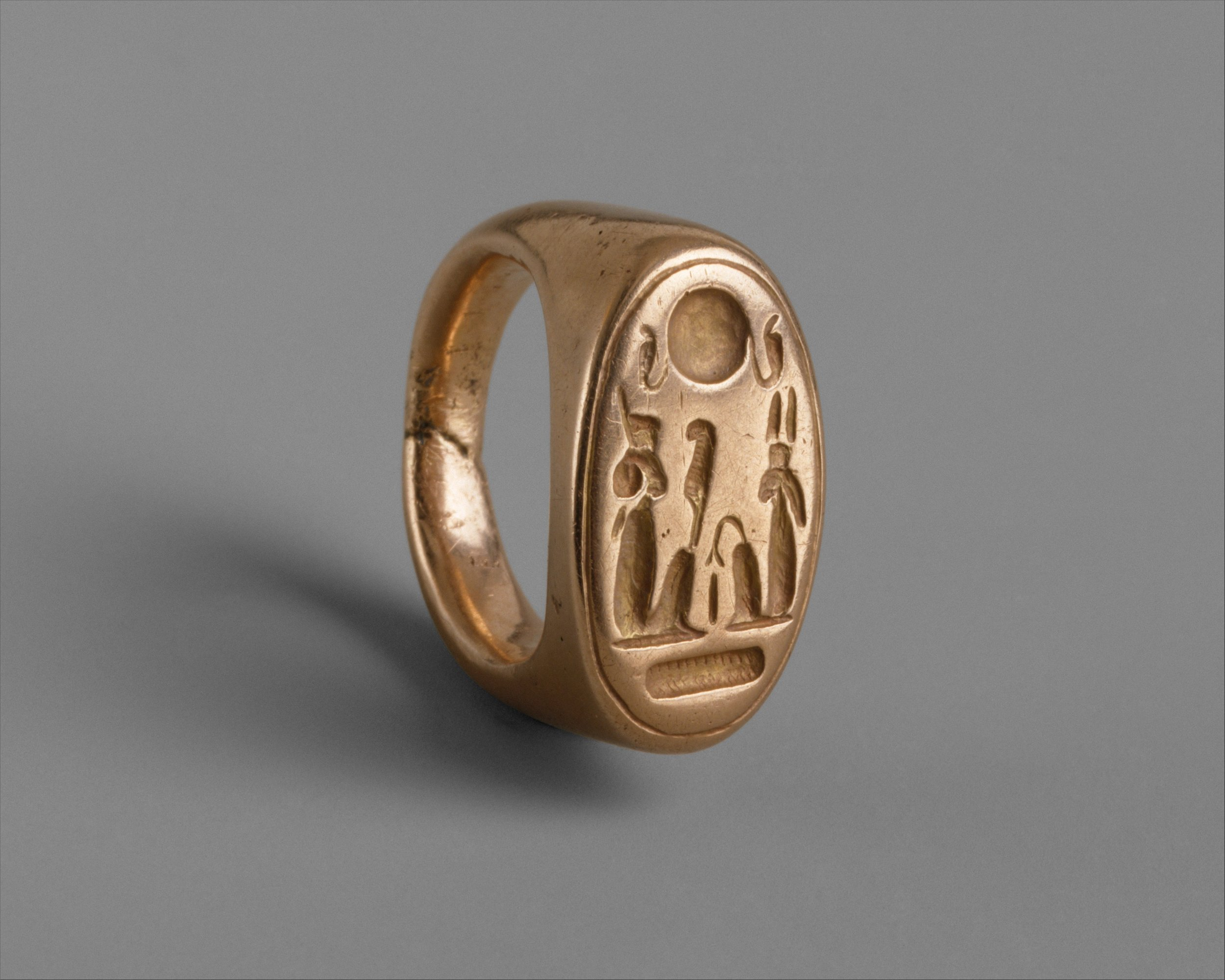 A fancy finger ring depicting Akhenaten and Queen Nefertiti as Shu and Tefnut. Divine as all get out.