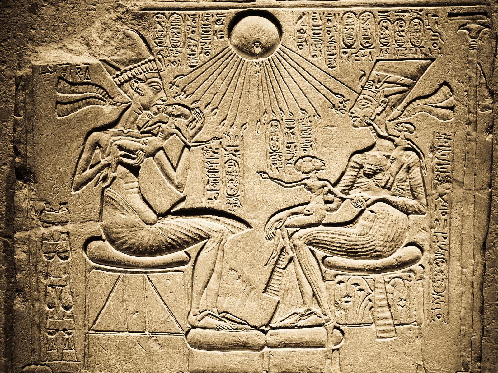 Nefertiti, Akhenaten and their daughters, getting sunburnt.