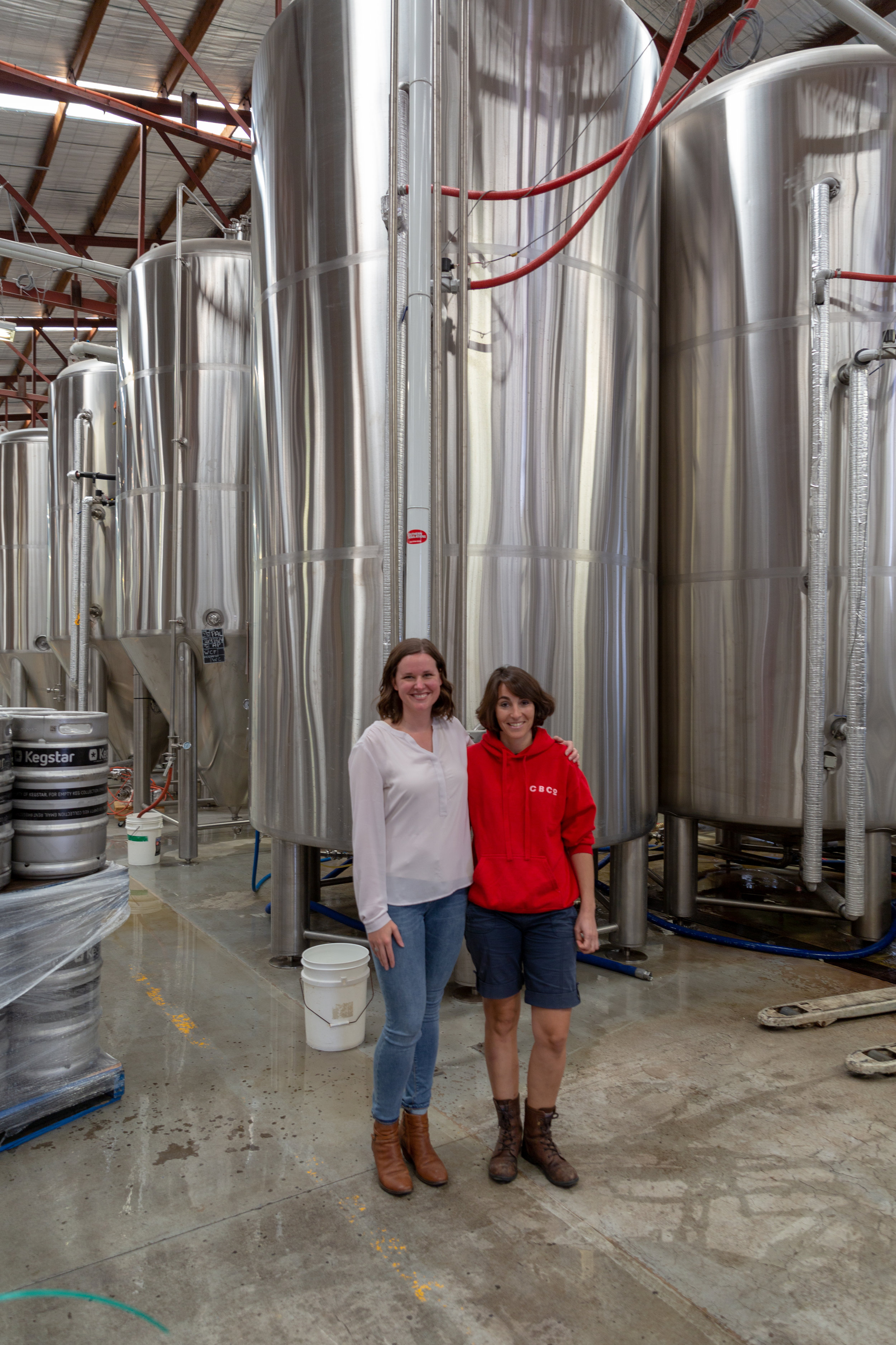 Flora and I hanging out by Colonial Brewing Co.'s giant tanks. To find out more about this delightful brewery, check out their website. - Image taken by Paul Gablonski
