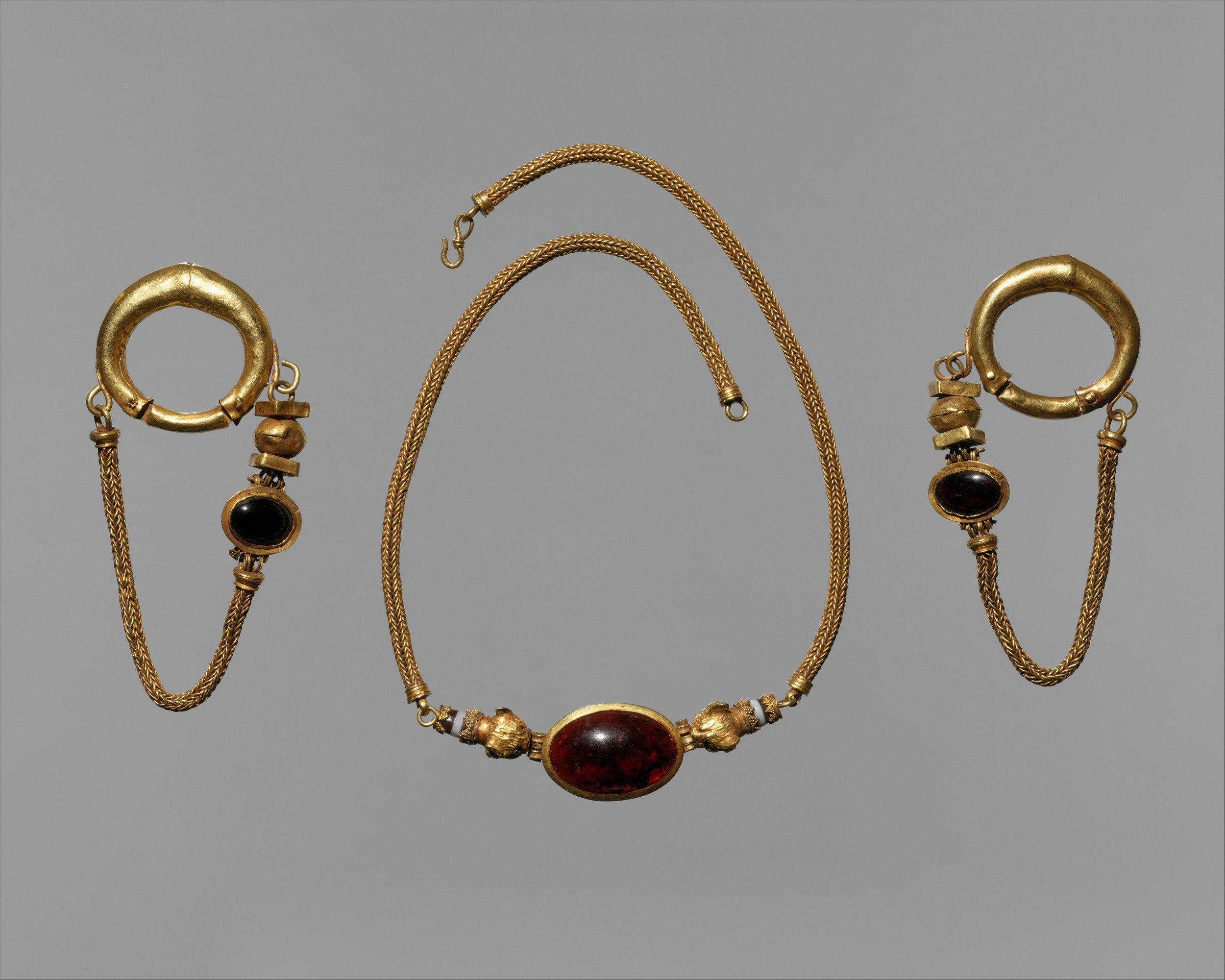 This necklace and earrings from 1st century BCE. form a blingy matching set featuring large garnets.   Courtesy of the Metropolitan Museum of Art