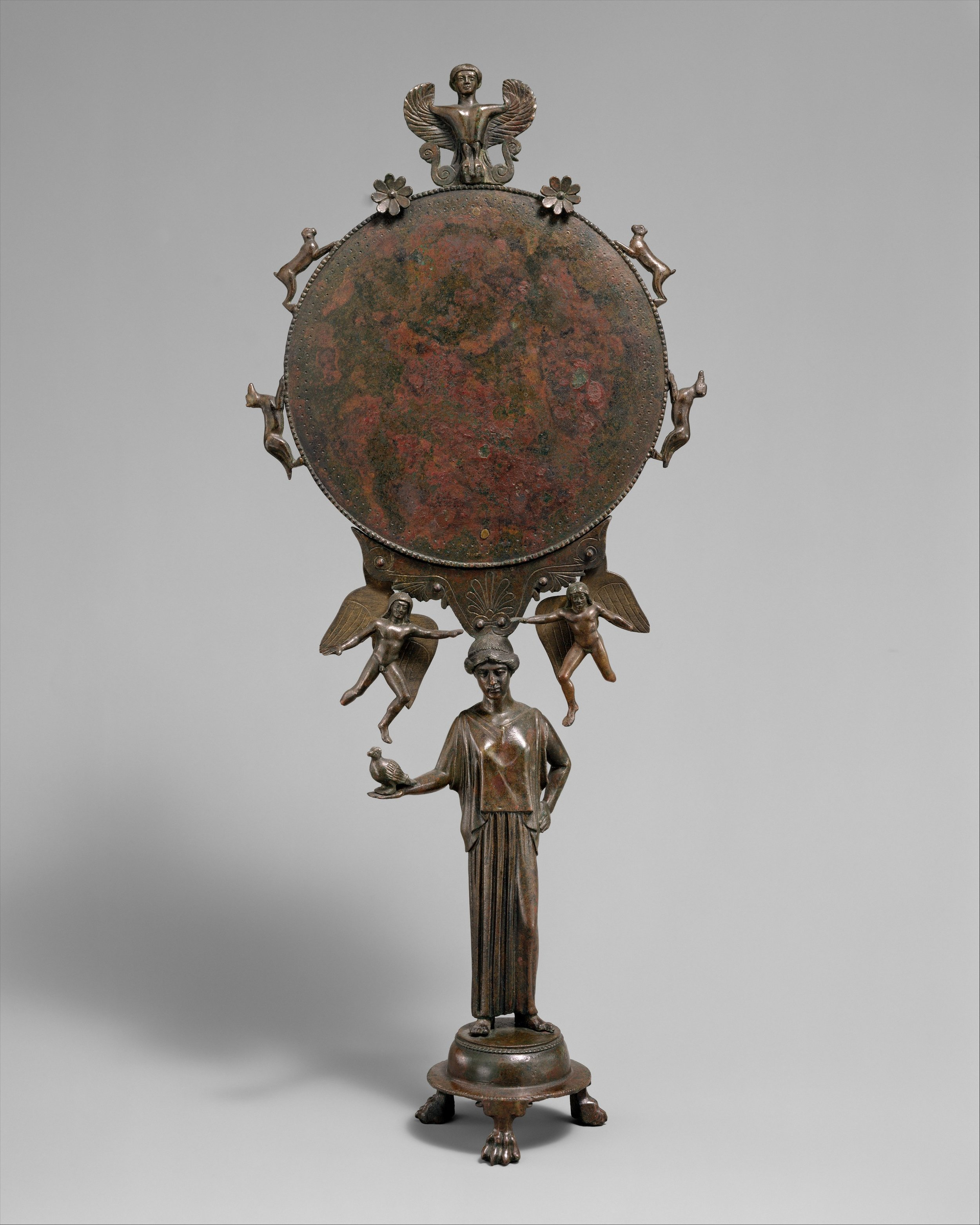 this bronze mirror has seen better days, but it's still pretty fancy. - Mid-fifth century BCE, courtesy of the MET.