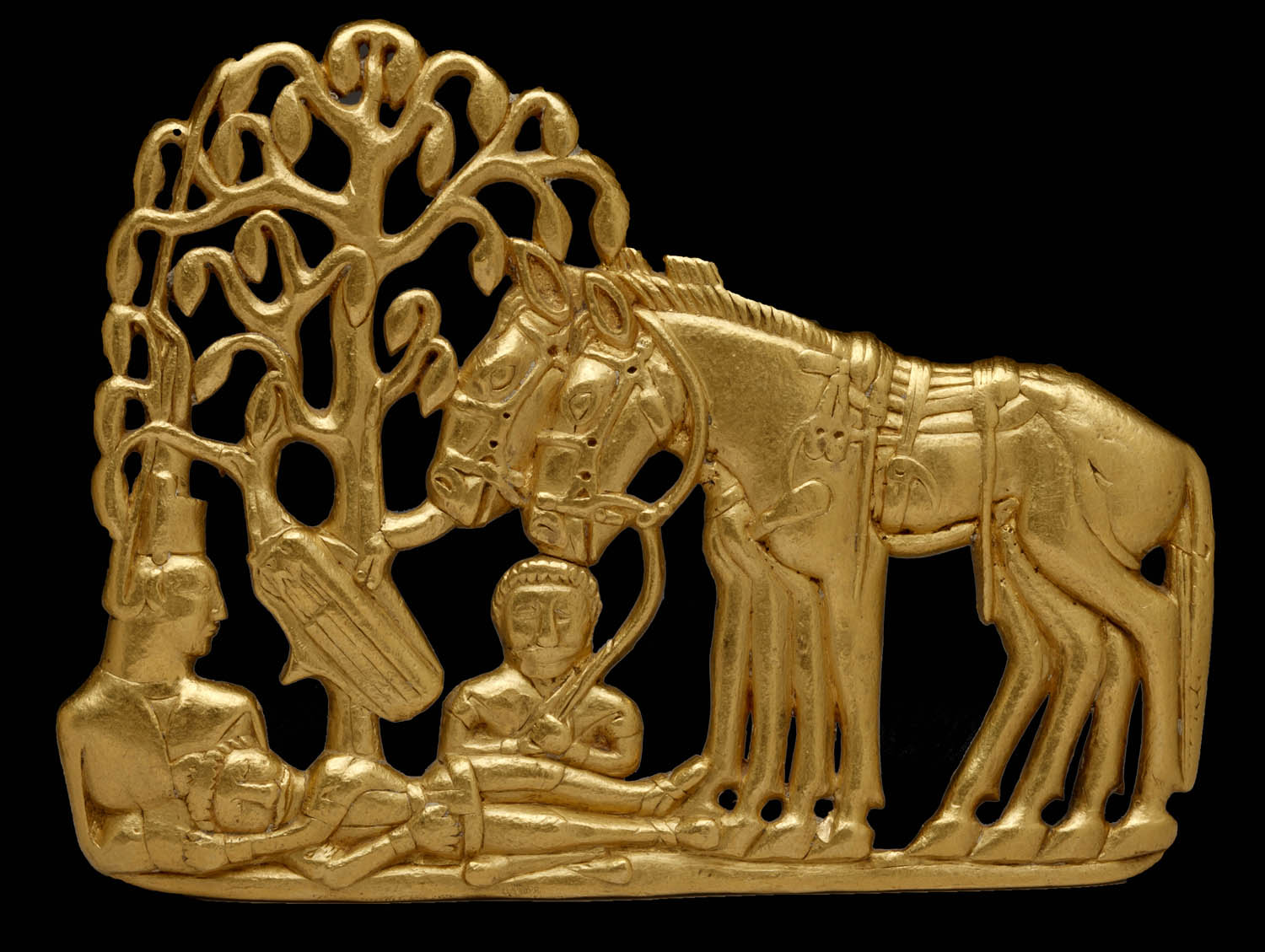In this gold belt plaque, we see Scythians with horses under a tree. Shiny!