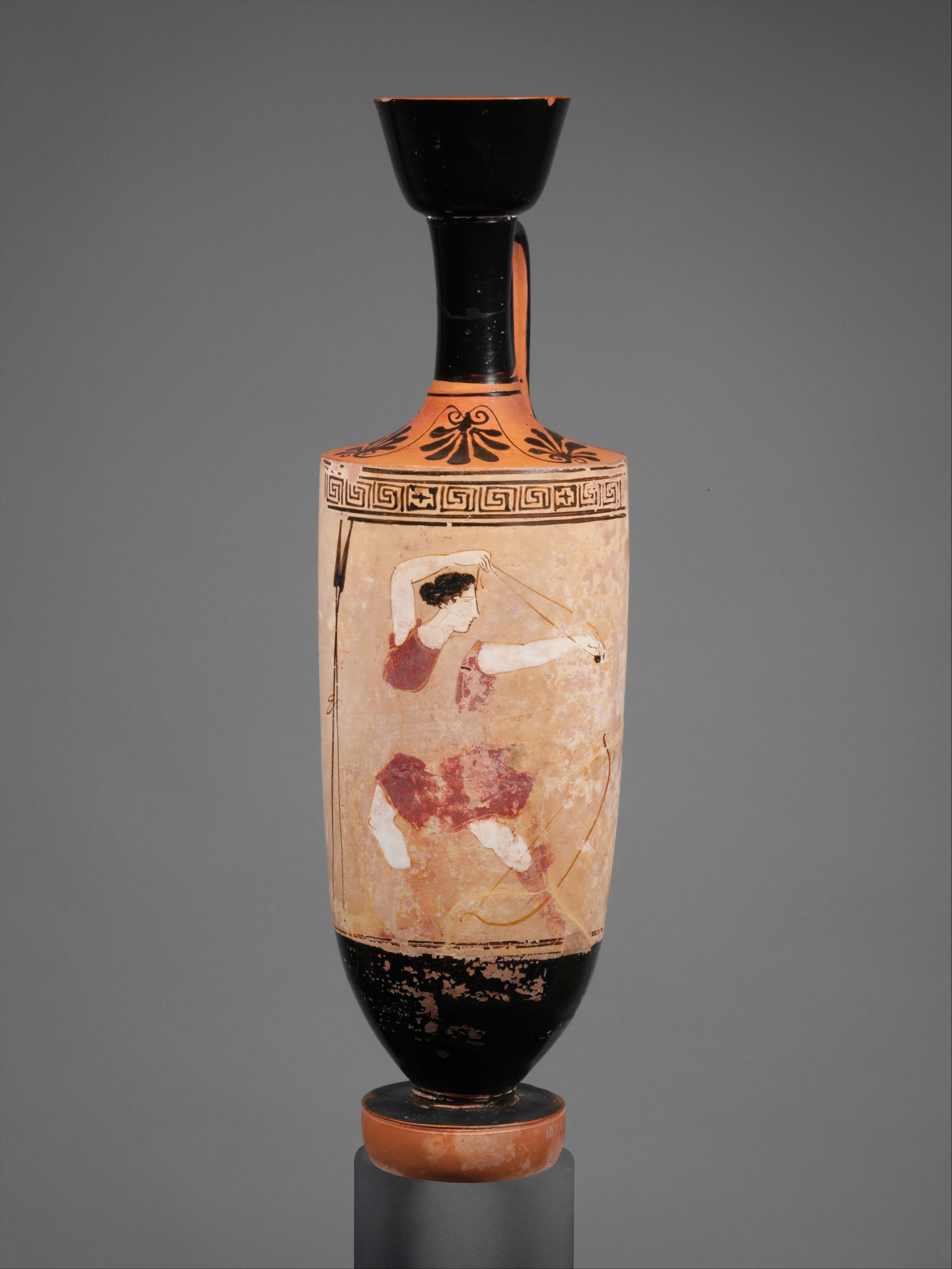 A terracotta lekythos (oil flask), ca. 440 BCE, showing an Amazon using a slingshot. Seriously: this is not a toy, okay? It's all fun and games until someone loses an eye. - Attributed to the Klügmann Painter. Courtesy of the Metropolitan Museum of Art.