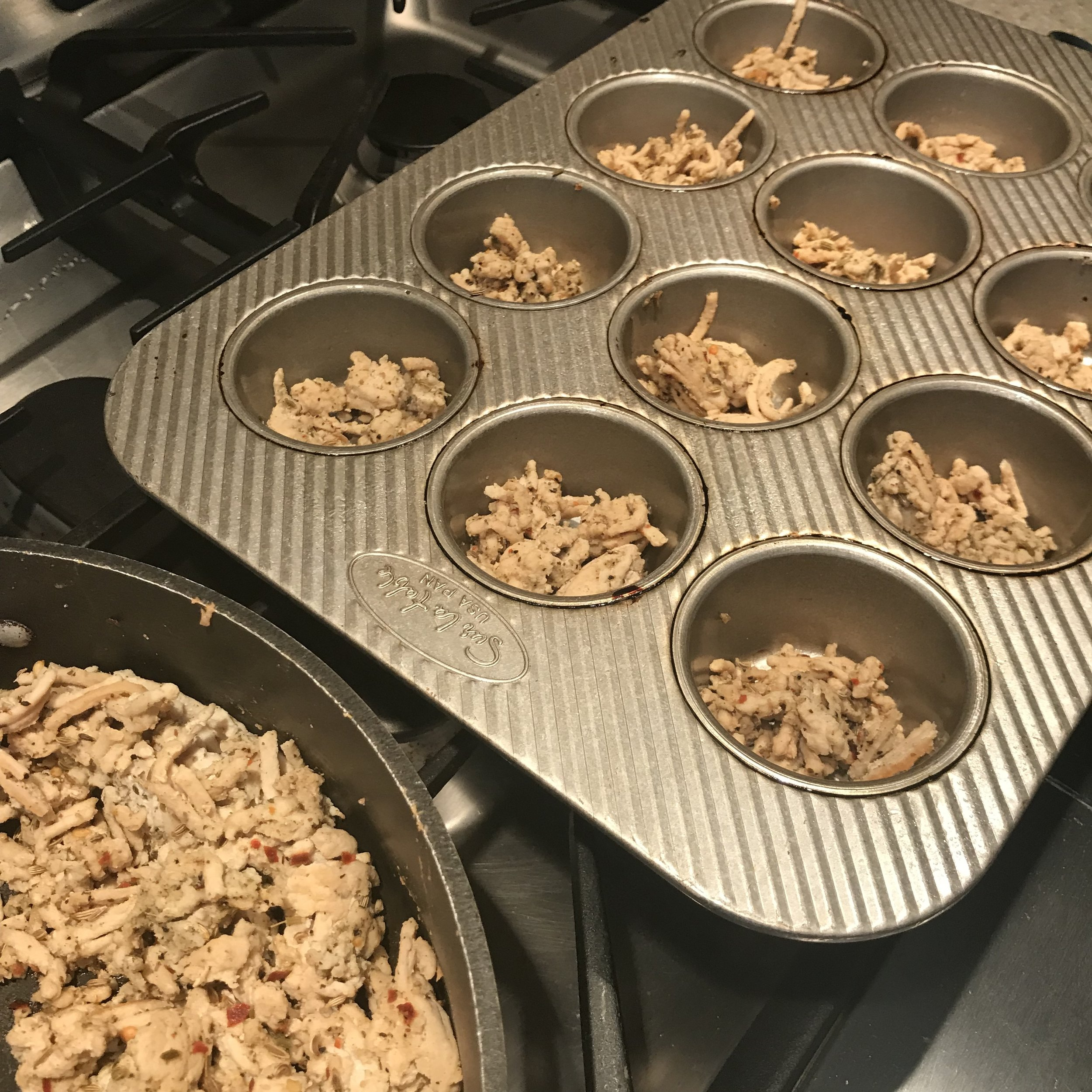 Add breakfast sausage crumble to greased cupcake pans. I use coconut oil spray.