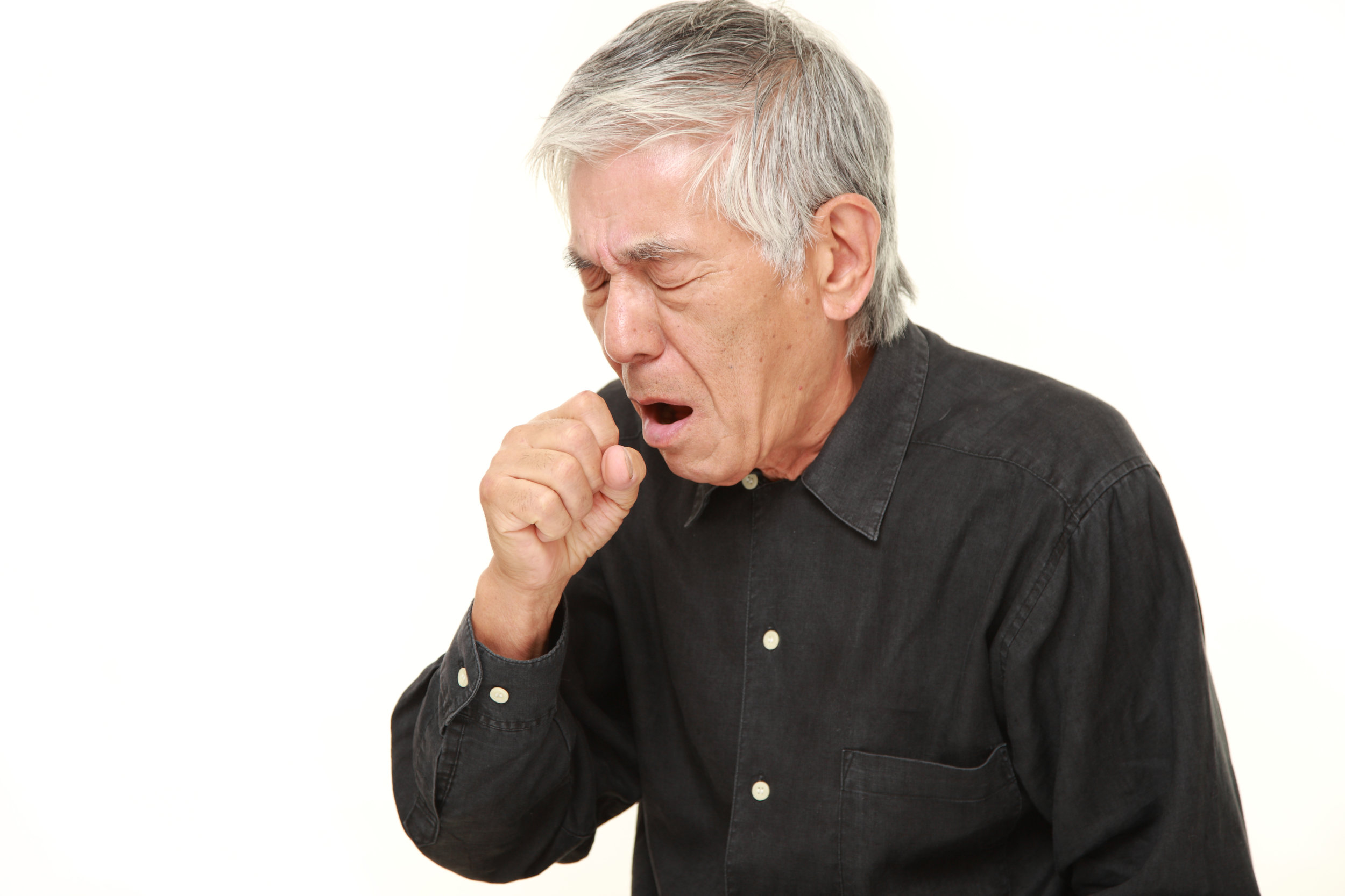 asian man coughing.jpeg