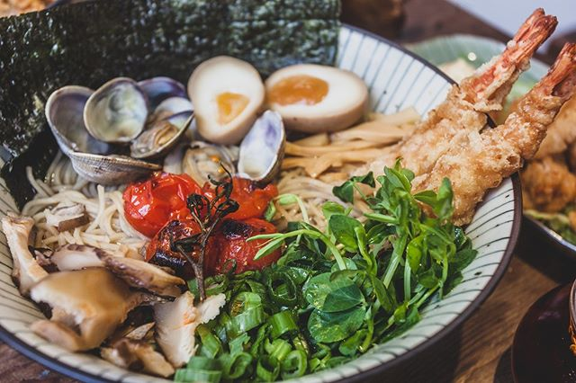 Our Spicy Tempura & Clams Ramen is Packed full of personality and flavour . A real bowl that pays homage and respect to the ocean, a must have for any seafood afficiando . #seafood #ramenshop #ramen #spicy #tempura #ramoramen #broth #londonfood #camdeneats #filipinofood