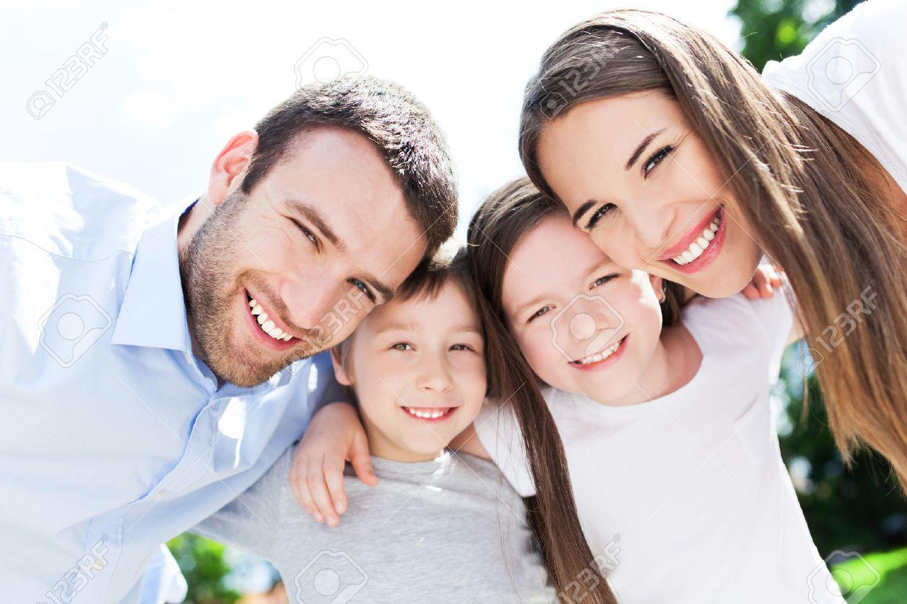 29670395-happy-family-outdoors-Stock-Photo.jpg