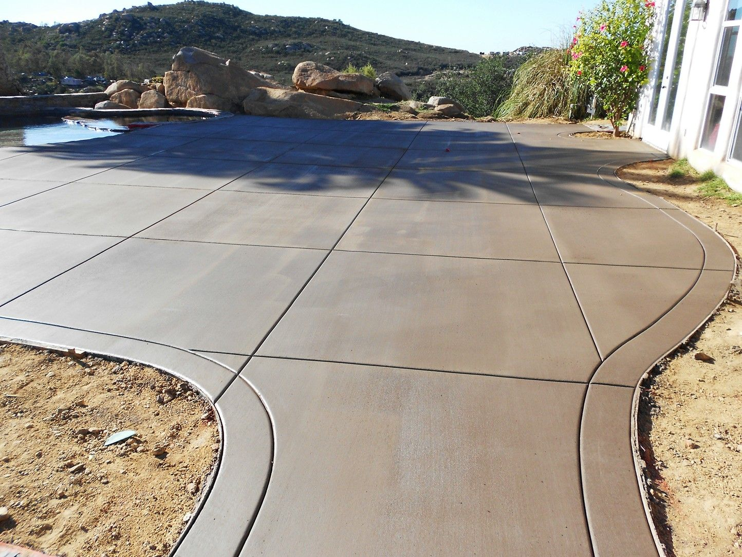 "Our Mission - We at San-Co Concrete, LLC will try very hard to ensure that for many years to come, you will have a long lasting, high quality concrete flat work inside and around your home. Whether it is your driveway, front porch, sidewalk, patio, garage or basement floor, we will do everything we can to satisfy you as a customer. All of our employees are trained to prepare, set up and place and finish concrete to the highest of industry standards. We work hard to keep up to date on the latest products and techniques as well as work with our suppliers and concrete producers to provide you with the highest quality materials. We offer several types of finishes. The most common that you see are exposed aggregate (with either 3/8"" rock or 3/4"" rock or a combo) and broom finishes. We also have a wide variety of stamped finish patterns in several different colors. Our signature finish is an acid etched/sand finish. This can be done with plain concrete or with some color added to it. Either way it is a nice option to consider. If you would like more information about our services please feel free to contact our friendly staff members at our office. Thank you for the opportunity to work with you, and for choosing our company for your concrete needs. We hope you are completely satisfied and that you may recommend us to your family and friends!San-Co Concrete, LLC."