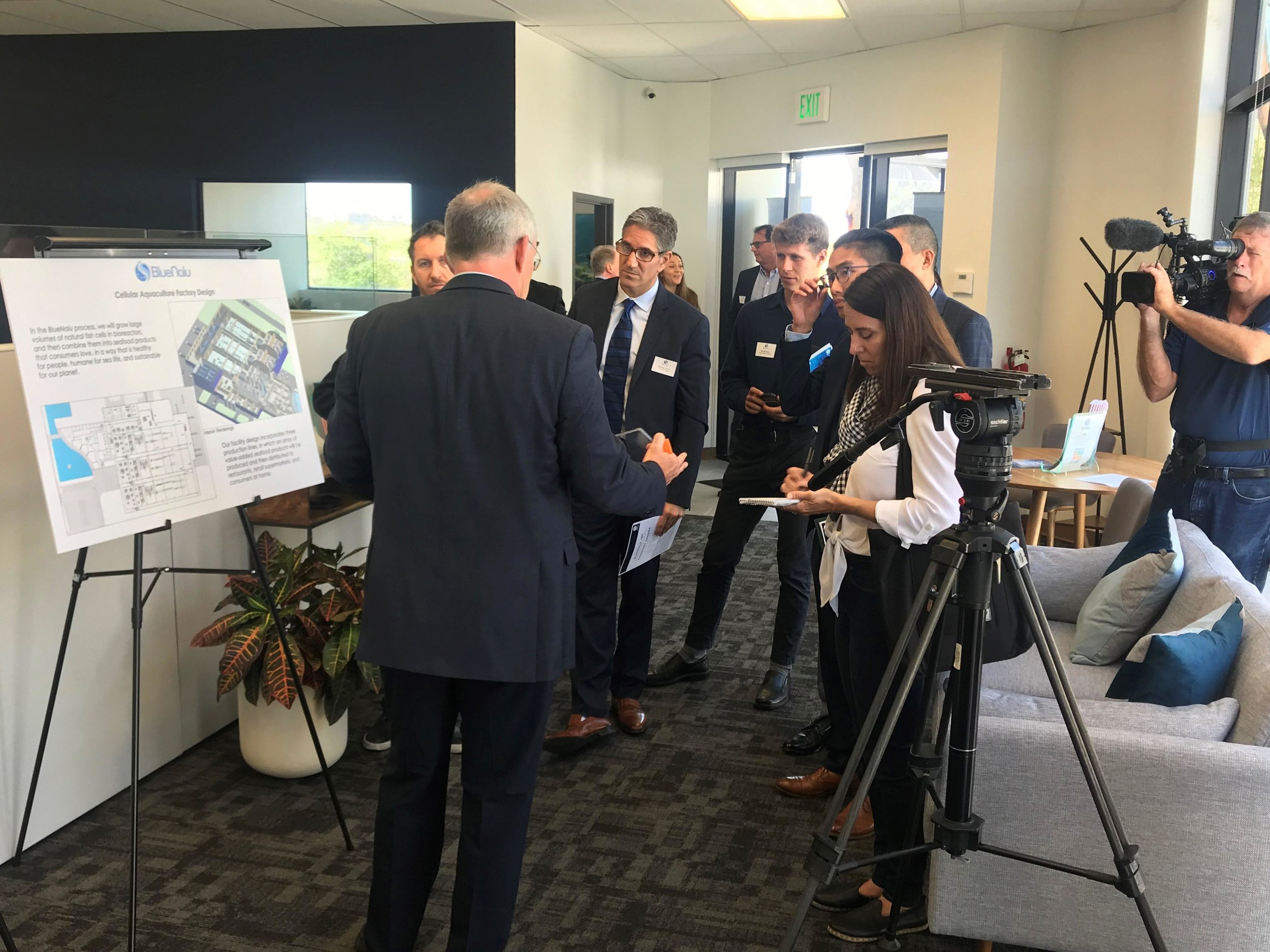 Behind the scenes at the BlueNalu Ribbon Cutting Ceremony, Earth Day, April 22, 2019. Bert Frohlich, VP Process Engineering, discusses commercialization plans with the media.