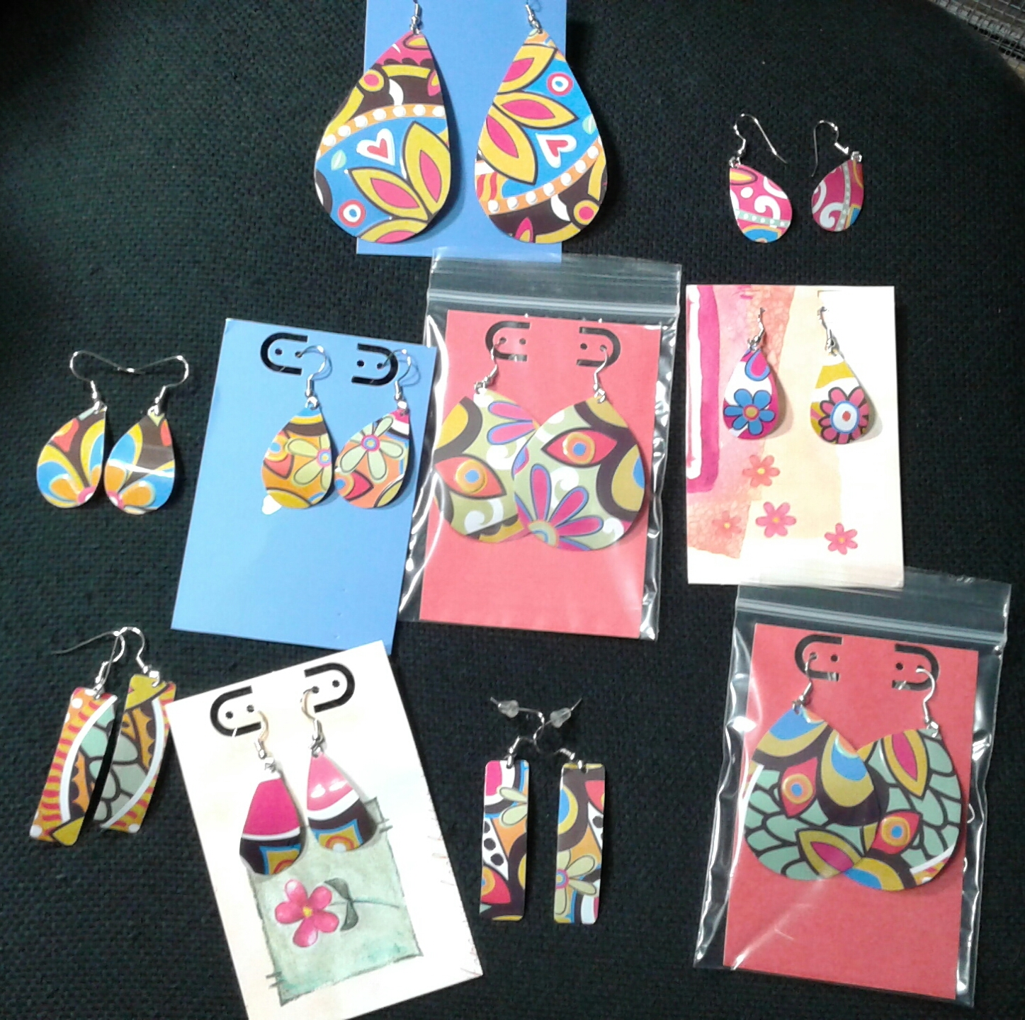 Mary's Originals - Hand-cut metal jewelry, made from recycled old tins &trays.