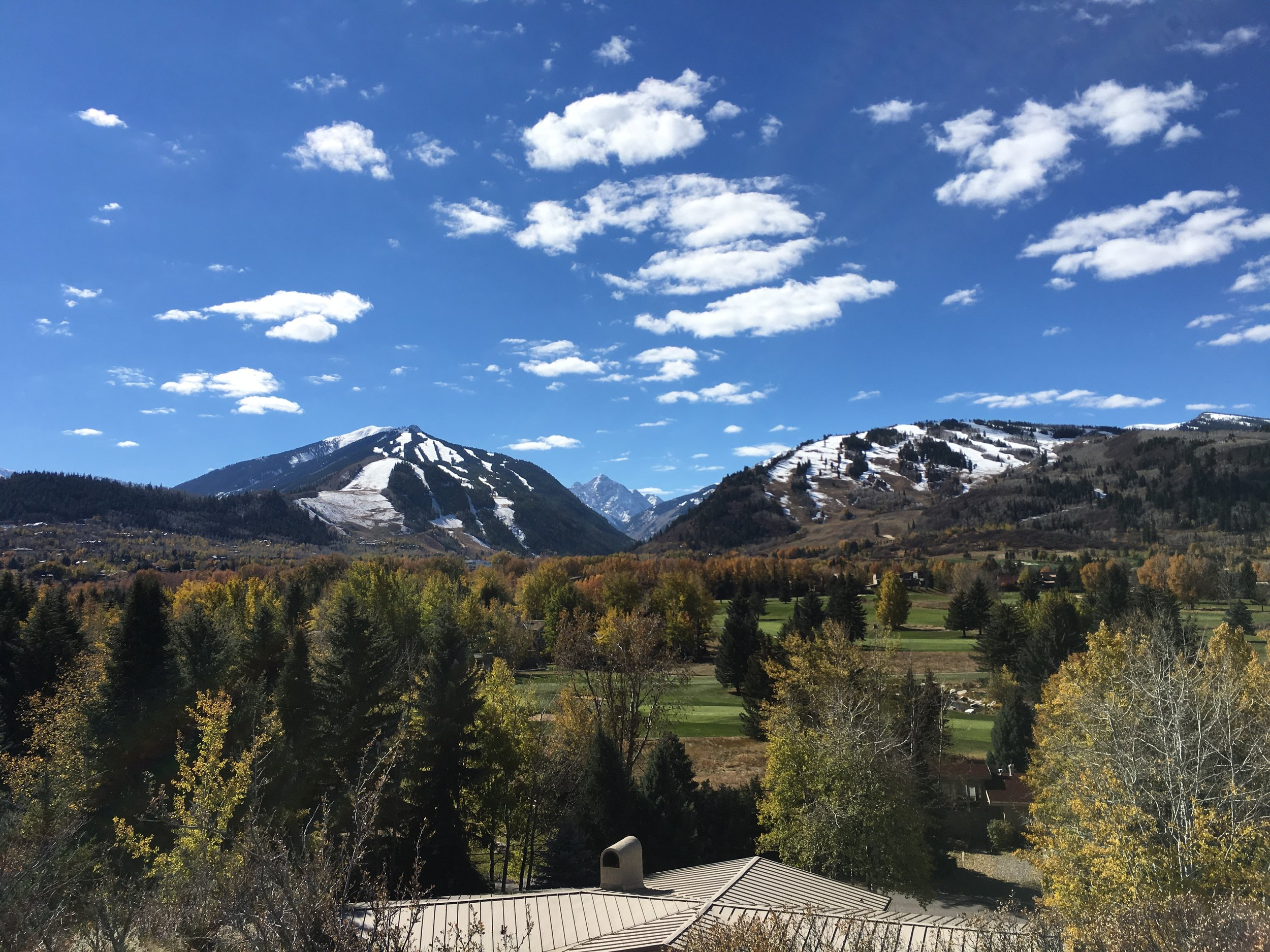 View from Red Butte (off Cemetery Lane) looking over the Aspen Golf Course up Maroon Creek with Aspen Highlands, Buttermilk and Pyramid Peak in the distance.
