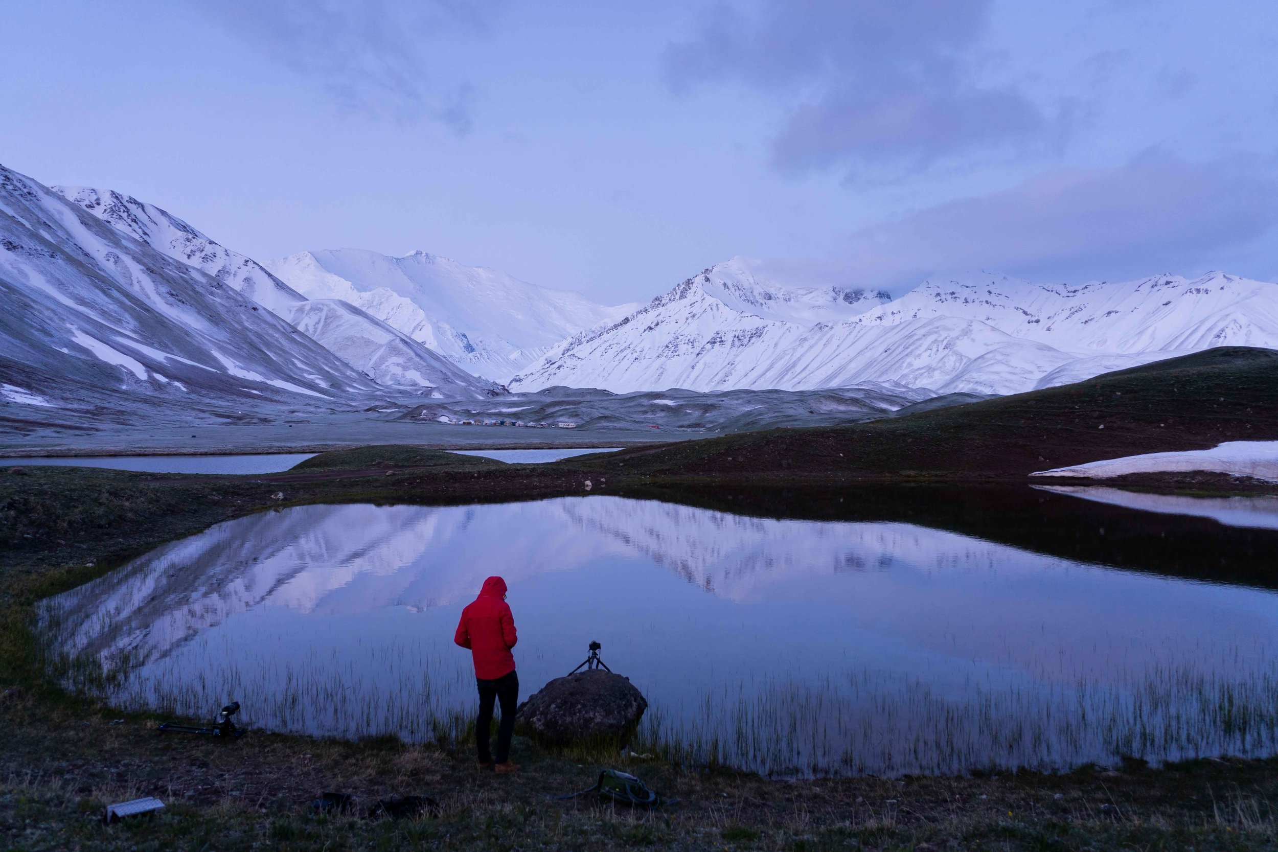 Lenin Peak on the left at Sunrise and Albert Dros shooting the reflection