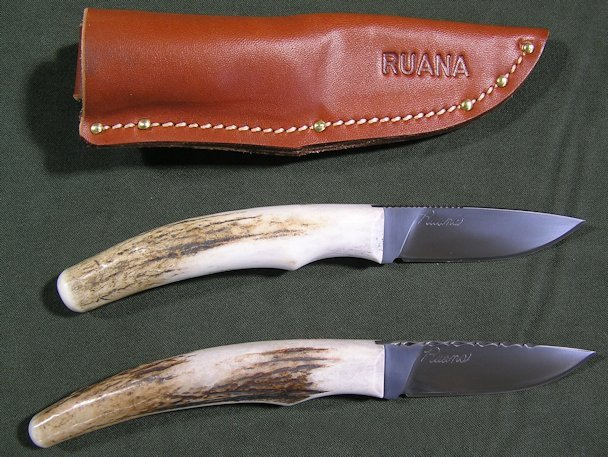 "Antler Tip Knives - Mark Hangas designed these great every day carry knives. The most unique feature is the one of a kind elk antler tip handle on each knife. The handles can't be duplicated and provide a comfortable grip that measures anywhere from about 4"" – 4 ¾"" long. The 2 ¾"" hammer forged, drop-point blade has a half hidden tang and is: legal to carry in most states, designed for a variety of uses, and can be made with basic thumb notches or decorative file work. Each knife also comes with a high quality leather sheath that has been individually wet molded for a snug fit.Antler Tip with thumb notches ~ $ 350Antler Tip with file work ~ $ 380"