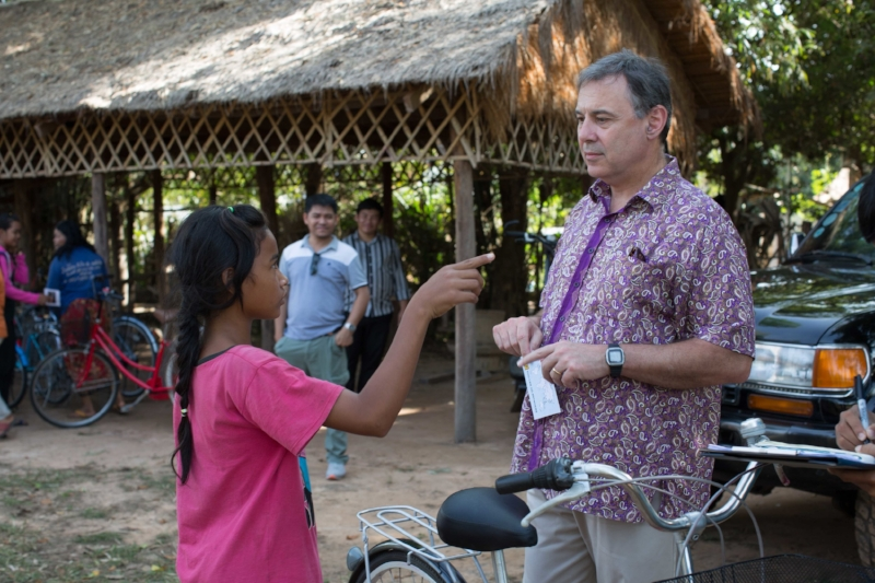 US Ambassador to Cambodia Bill Heidt joins a Moment of Happy near Siem Reap in 2017, endowing bikes then joining the girls for a bike ride!