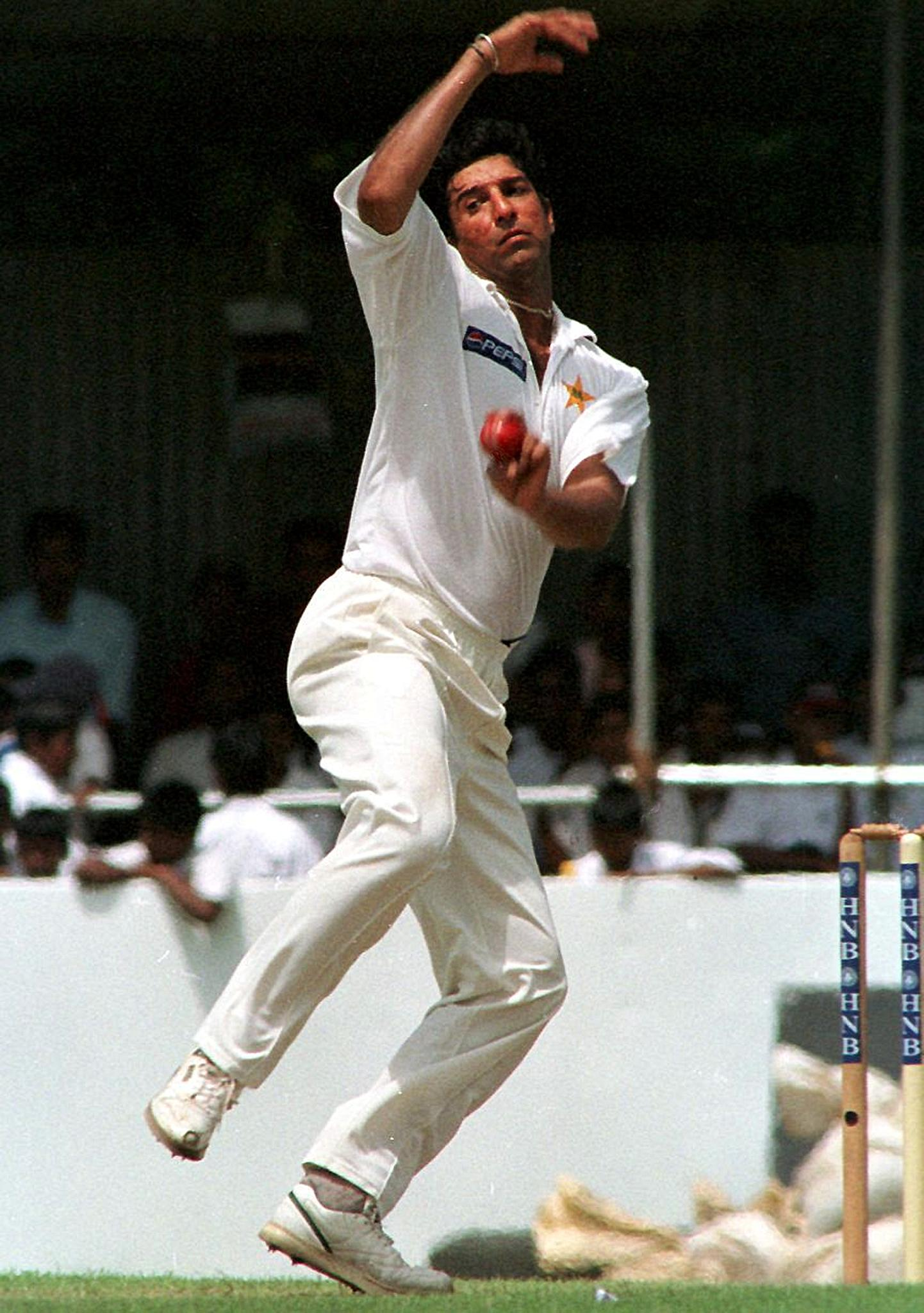 Pakistani fast bowler Wasim Akram winds up in a test match against Sri Lanka