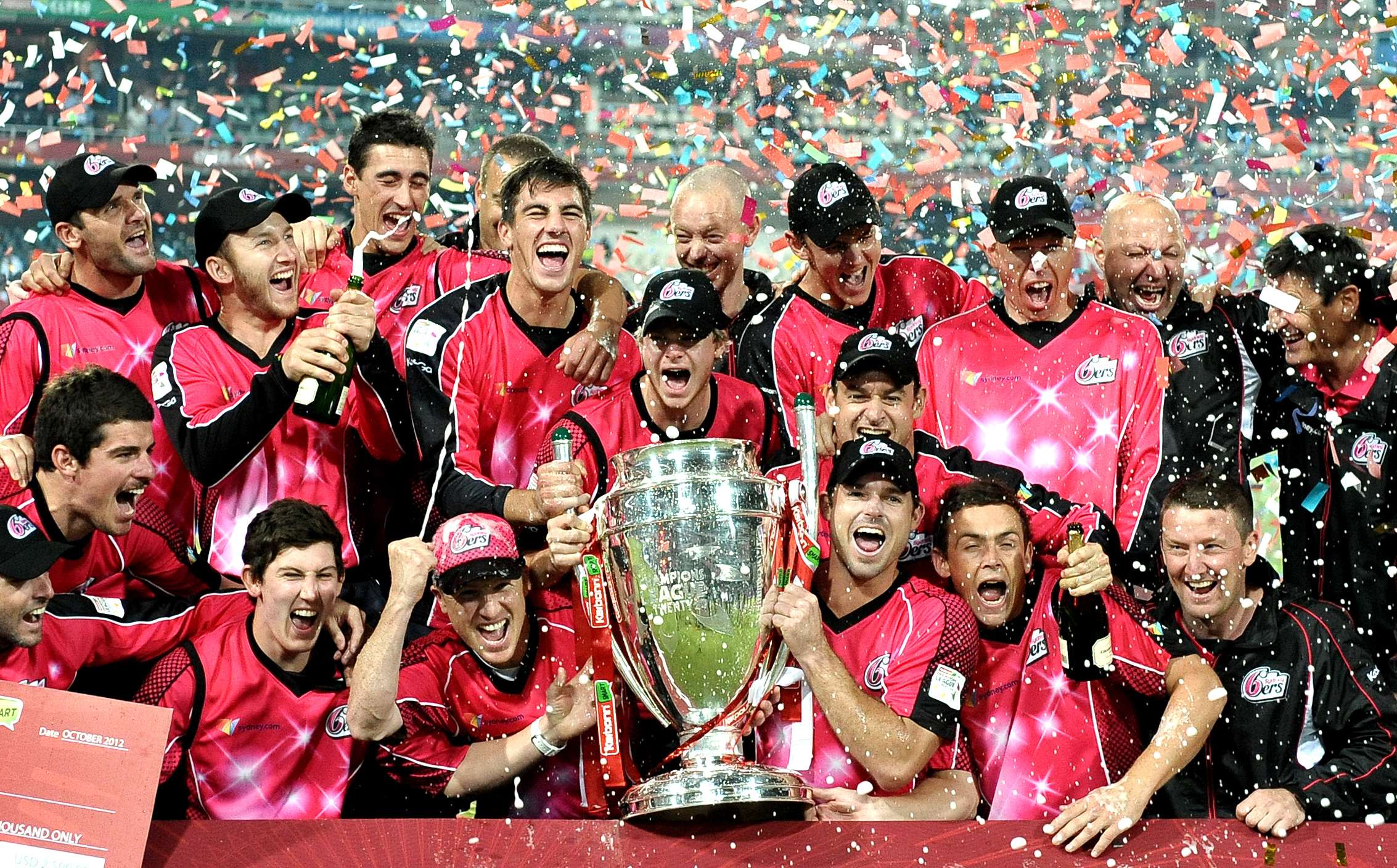 Sydney Sixers's celebrate their victory over the Lions on October 28, 2012 in the final Champions League T20