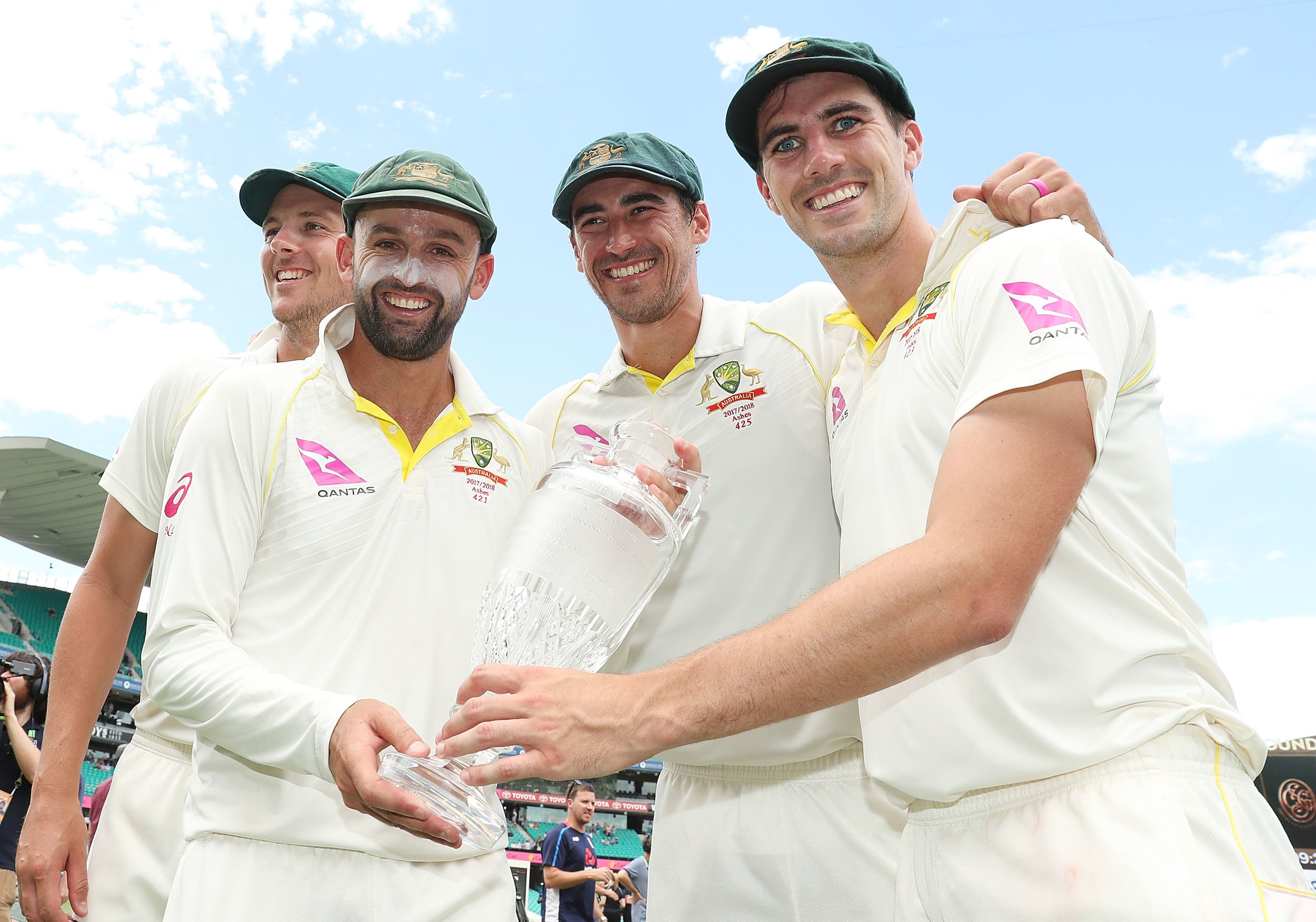 Nathan Lyon, Mitchell Starc, Pat Cummins and Josh Hazlewood pose with the Ashes trophy after winning the series during day five of the Fifth Test match in the 2017/18 Ashes Series