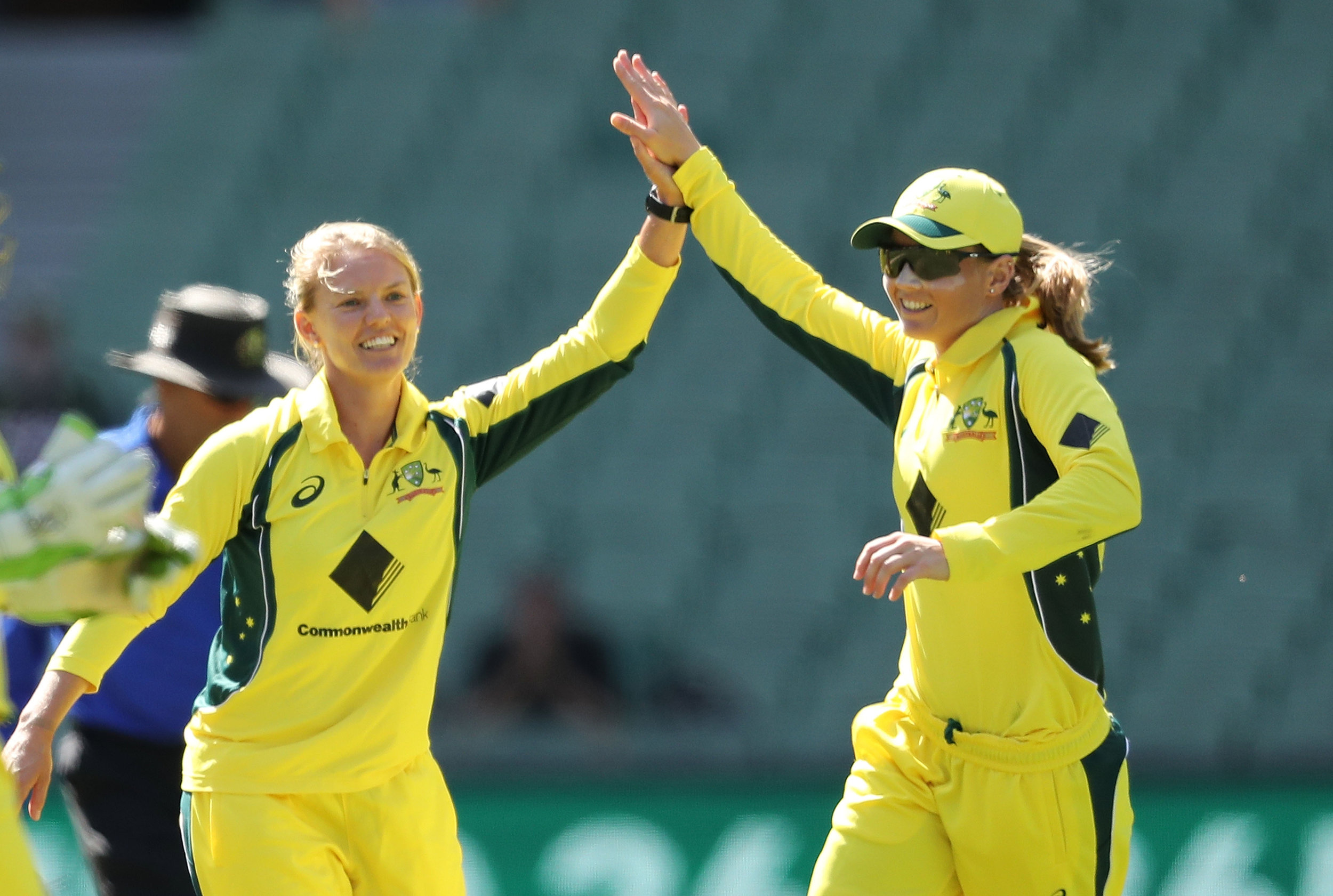 Kristen Beams of Australia celebrates with Meg Lanning after dismissing Suzie Bates of New Zealand