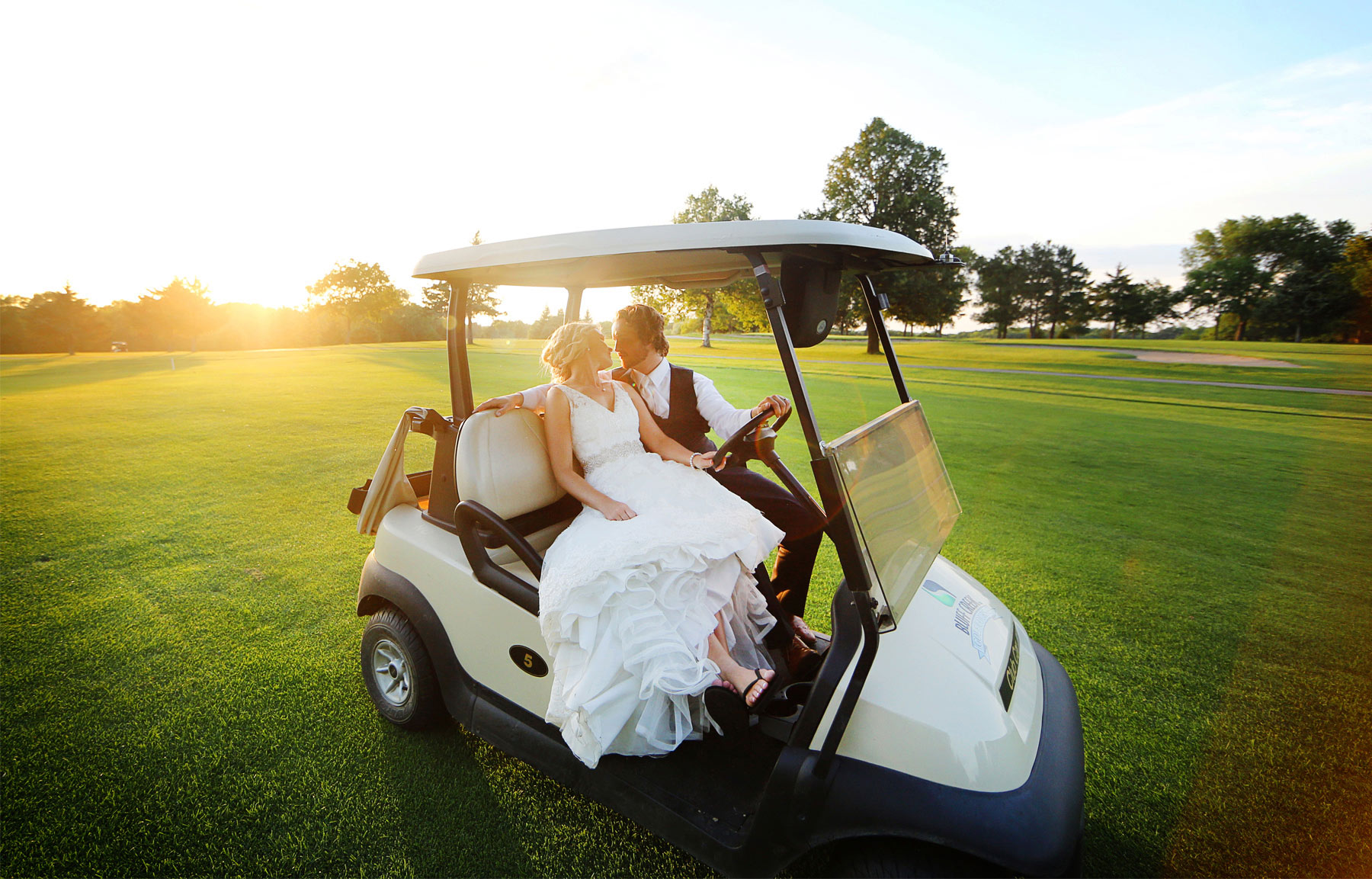 19-Minneapols-Minnesota-Wedding-Photography-by-Vick-Photography--Bluff-Creek-Golf-Club-Reception-Sunset-Golf-Cart-Gretchen-&-Peter.jpg