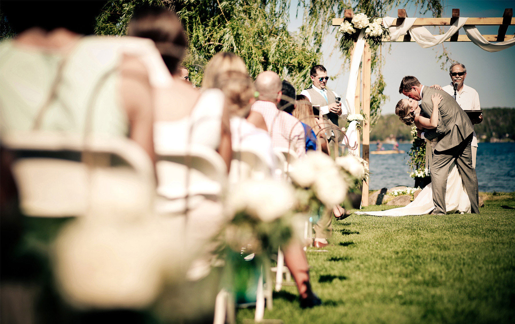 12-Brainerd-Minnesota-Wedding-Photography-by-Vick-Photography-Craguns-Resort-Outdoor-Lake-Ceremony-First-Kiss-Lucy-&-Matt.jpg