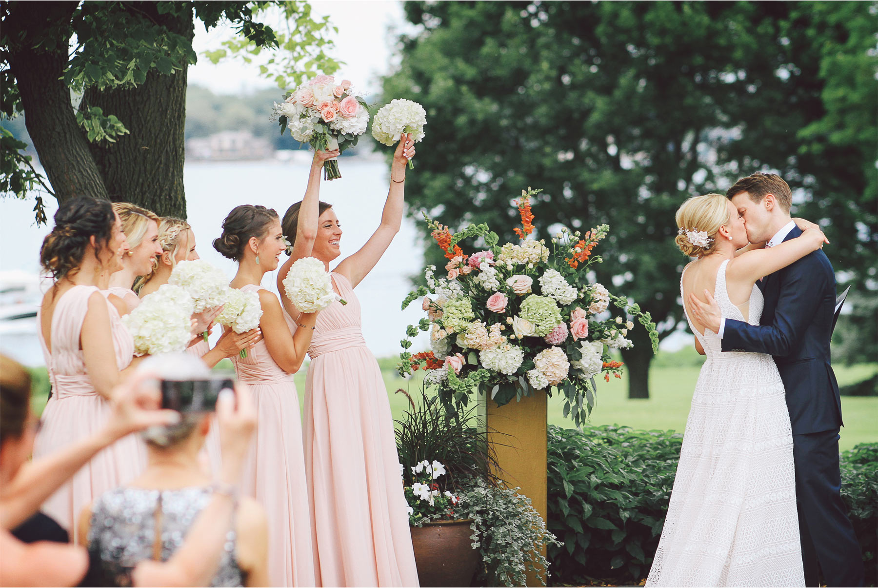 12-Minneapolis-Minnesota-Wedding-Photography-by-Vick-Photography-Lafayette-Club-Outdoor-Ceremony-Kiss-Cheering-Maggie-and-Nicholas.jpg