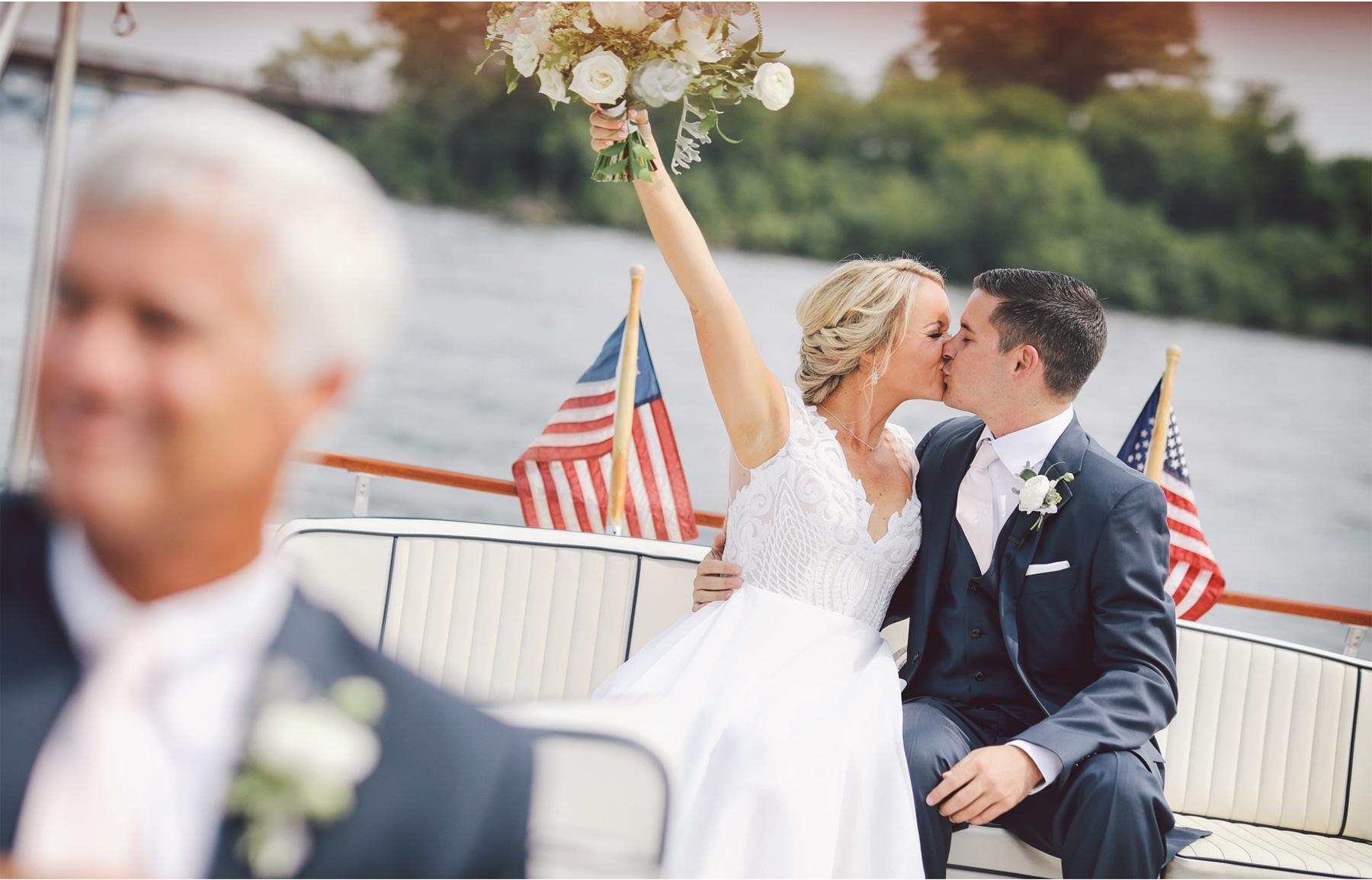 08-Minnetonka-Minnesota-Wedding-Photography-by-Vick-Photography-Boat-Lake-Minnetonka-First-Meeting-Toast-Jennifer-and-Adam.jpg