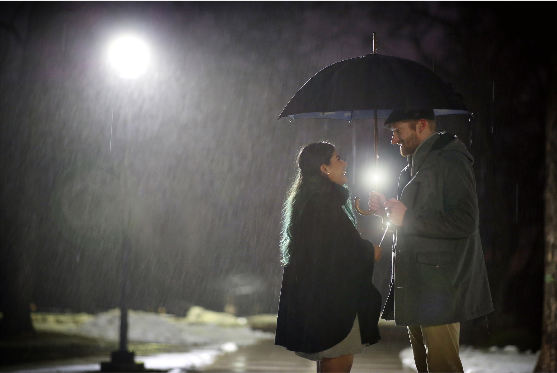 11-Harry-Potter-Themed-Engagement-Session-Minnesota-Wedding-Photography-Andrew-Vick-Night-Rain-Glowing-Wands-Elena-and-Doug.jpg