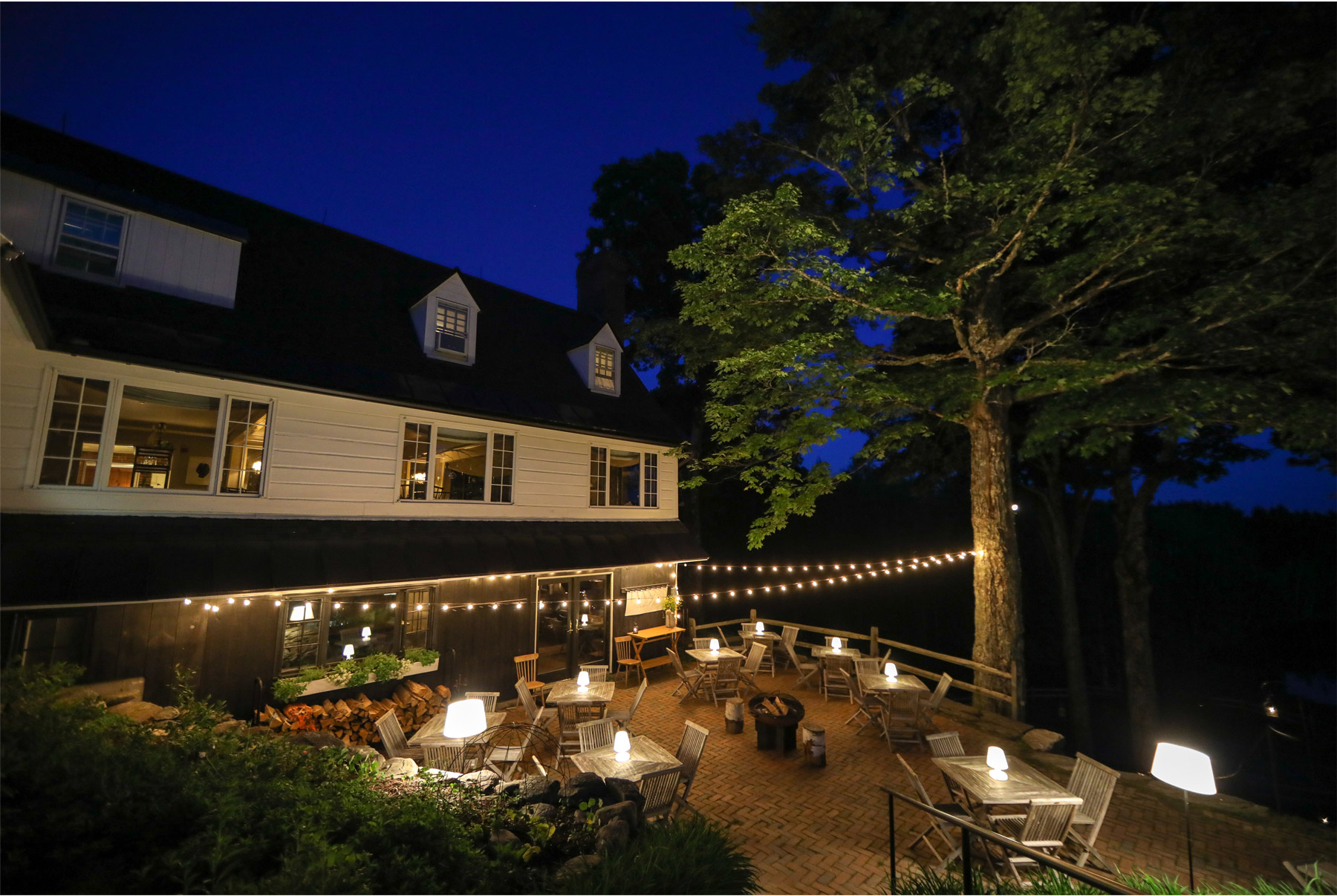 05-Stowe-Vermont-by-Andrew-Vick-Photography-Edson-Hill-Summer-Lodge-Patio-Night.jpg