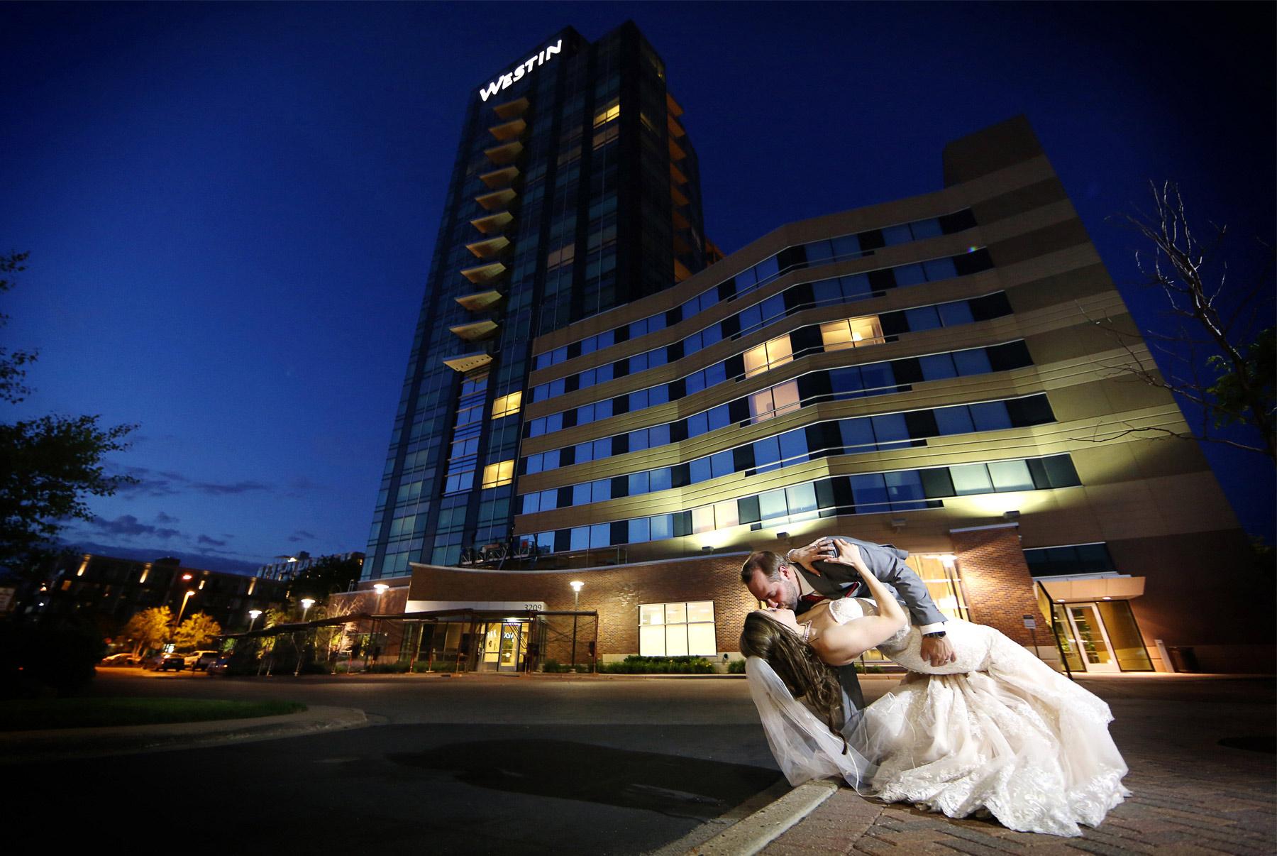 26-Minneapolis-Minnesota-Wedding-Photographer-by-Andrew-Vick-Photography-Summer-Edina-Westin-Hotel-Kiss-Dip-Embrace-Night-Outside-Bride-Groom-Natalie-and-Andrew.jpg