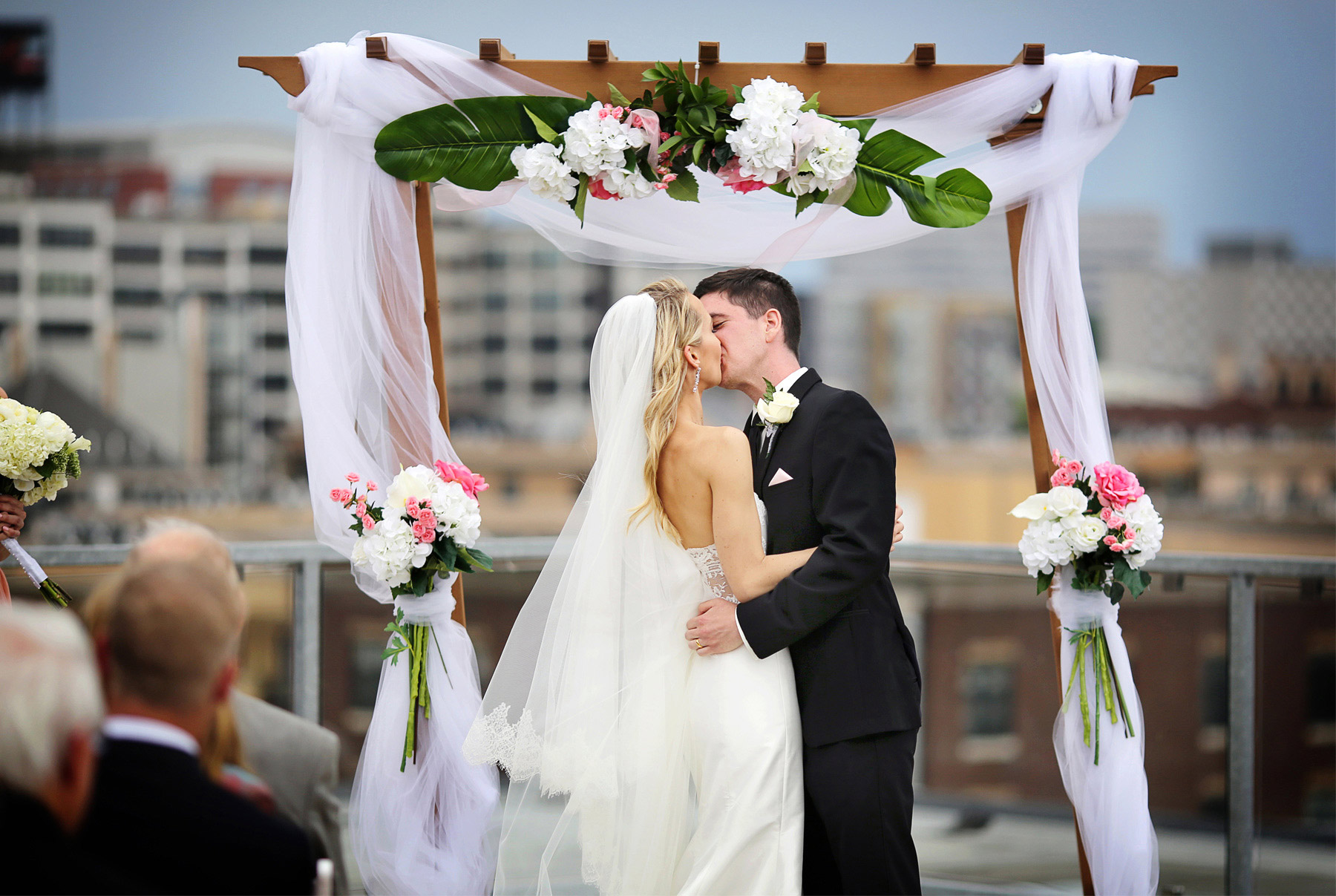 14-Saint-Paul-Minnesota-Wedding-Photographer-by-Andrew-Vick-Photography-Summer-Abulae-Ceremony-Groom-Bride-Dress-Kiss-Embrace-Laura-and-Tim.jpg
