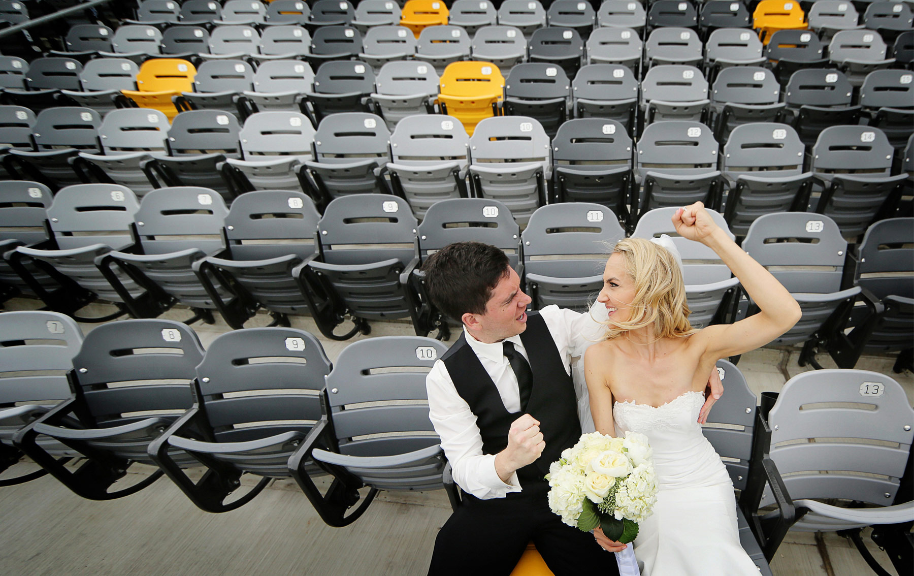 19-Saint-Paul-Minnesota-Wedding-Photographer-by-Andrew-Vick-Photography-Summer-CHS-Field-Stadium-Bride-Groom-Dress-Baseball-Saints-Cheering-Flowers-Laura-and-Tim.jpg