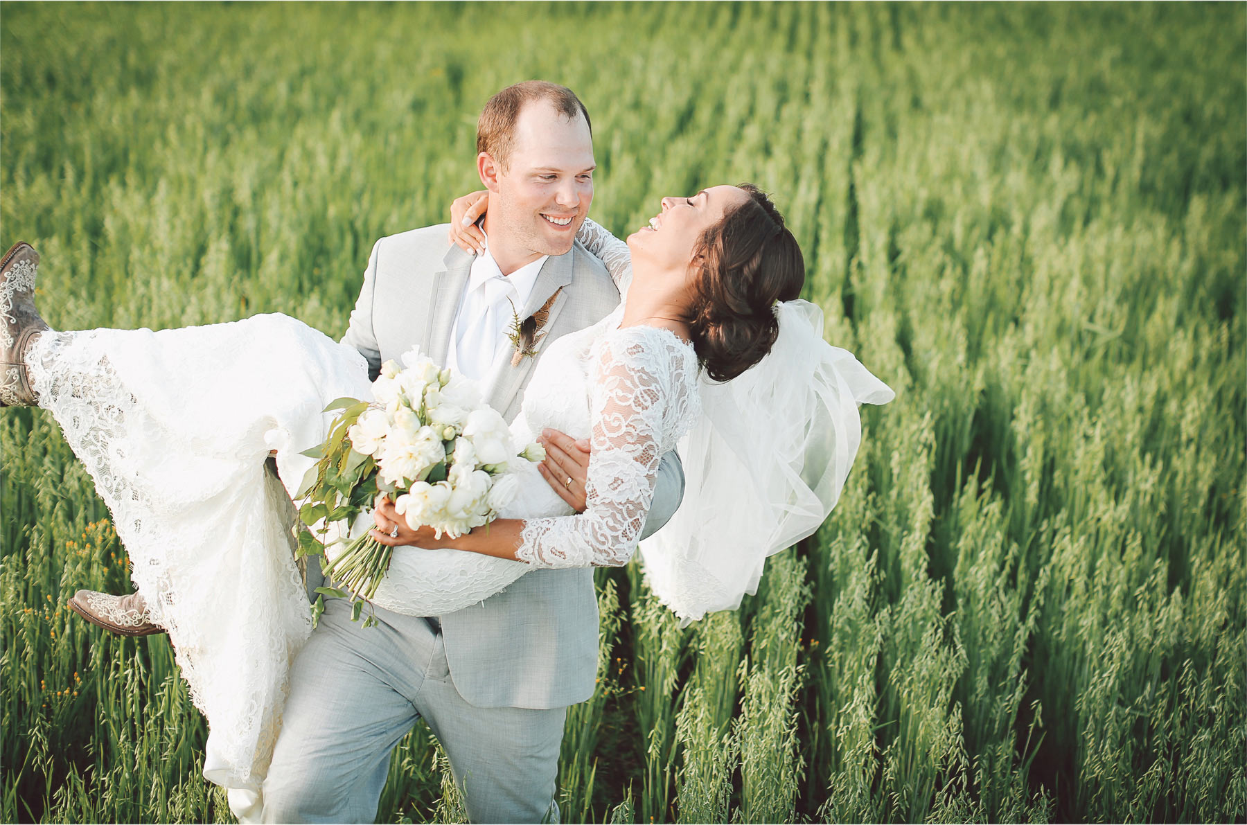 23-South-Haven-Minnesota-Wedding-Photographer-by-Andrew-Vick-Photography-Summer-Tomala-Farm-Field-Bride-Groom-Carry-Flowers-Dress-Vintage-Renee-and-Bobb.jpg