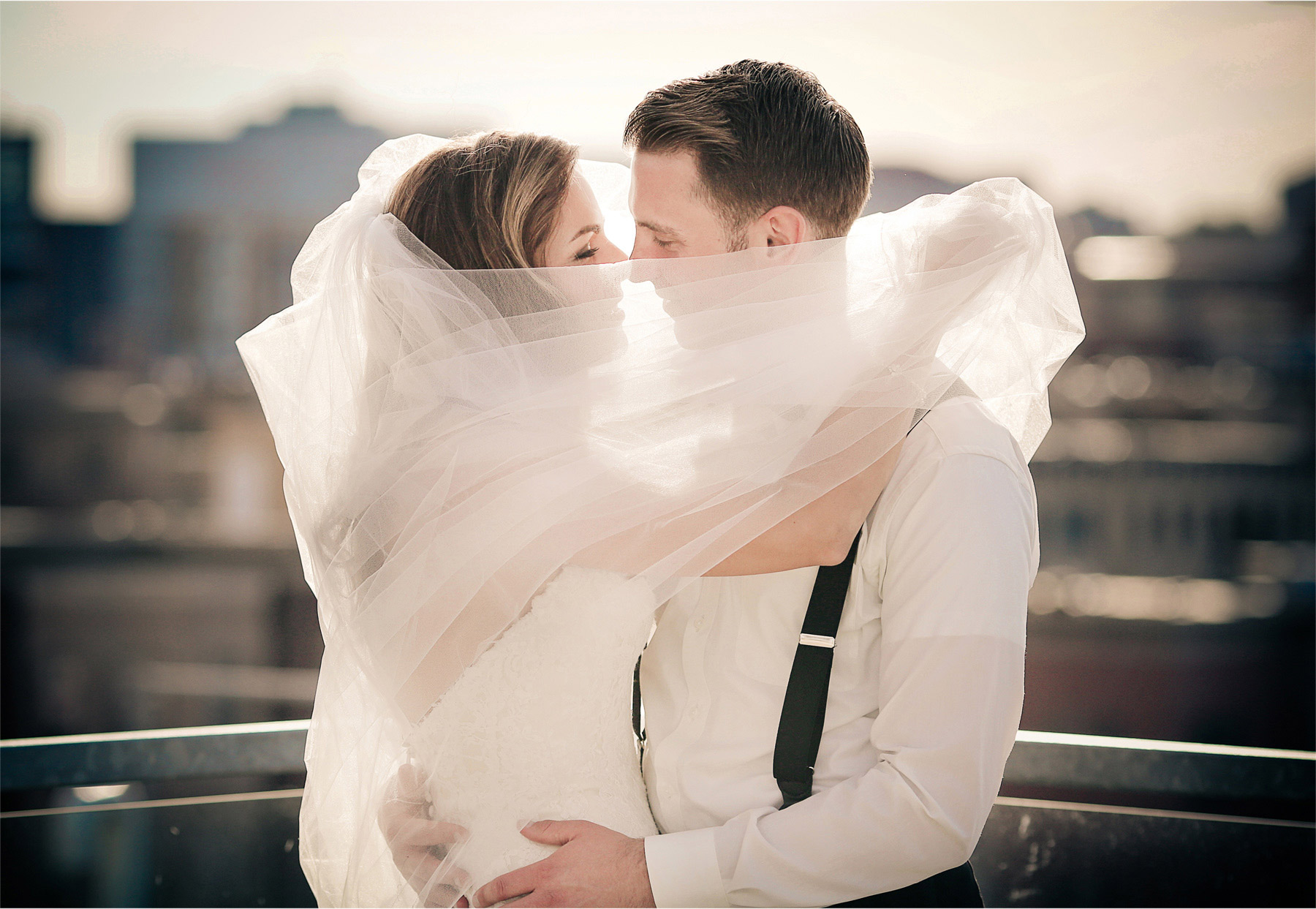 23-Saint-Paul-Minnesota-Wedding-Photographer-by-Andrew-Vick-Photography-Summer-Abulae-Bride-Groom-Suspenders-Veil-Embrace-Vintage-Molly-and-Dan.jpg