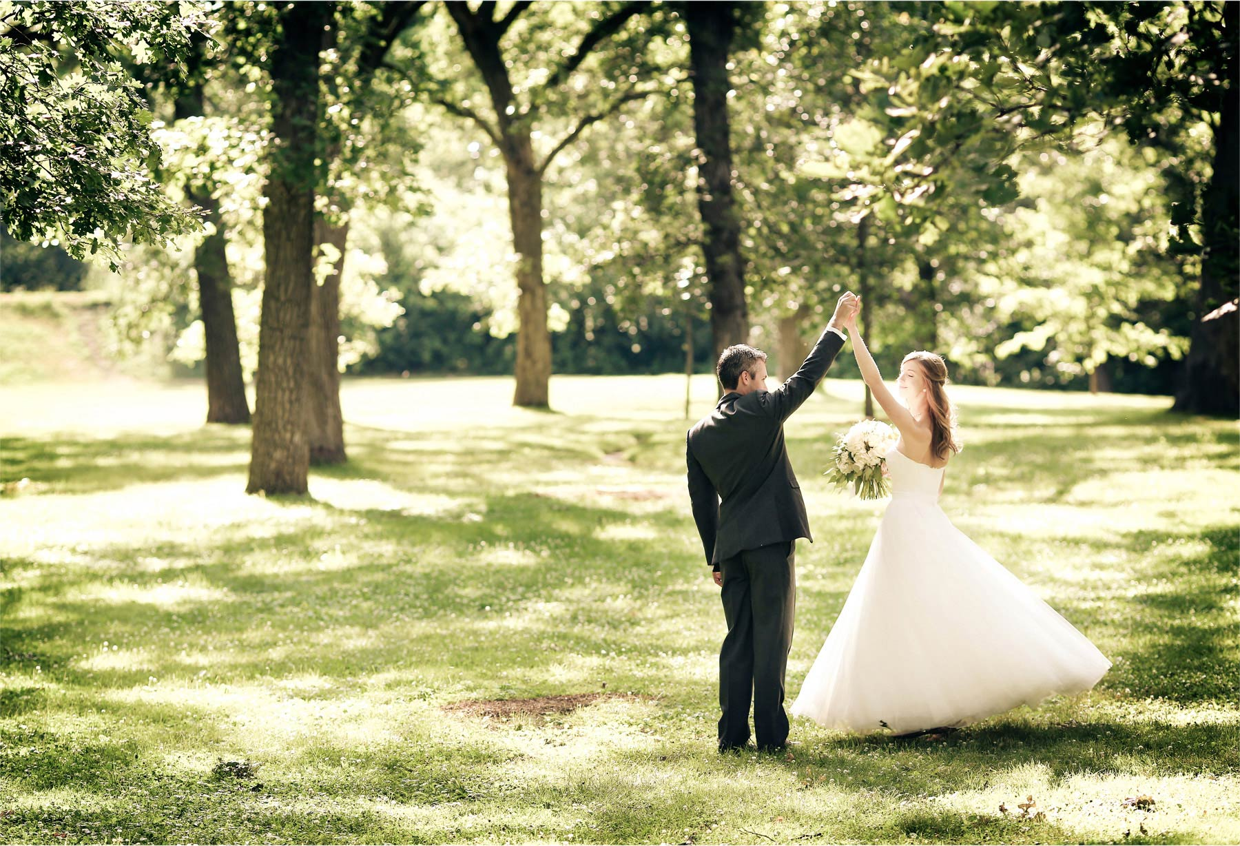 11-Minneapolis-Minnesota-Wedding-Photographer-by-Andrew-Vick-Photography-Summer-Woods-Bride-Groom-Dance-Twirl-Vintage-Katie-and-Travis.jpg
