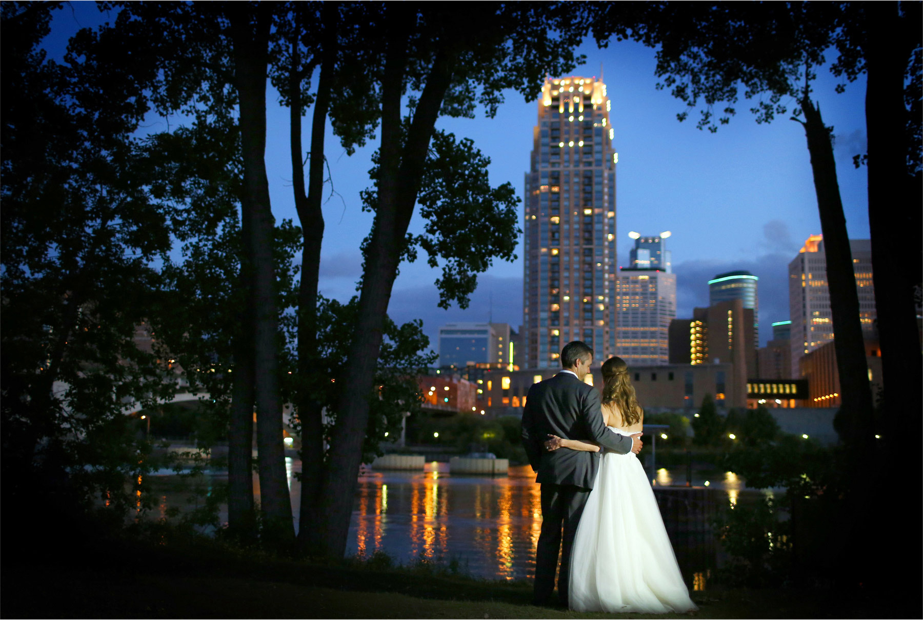 21-Minneapolis-Minnesota-Wedding-Photographer-by-Andrew-Vick-Photography-Summer-Bride-Groom-Nicollett-Island-Pavilion-Embrace-Dress-Downtown-Night-Mississippi-River-Katie-and-Travis.jpg