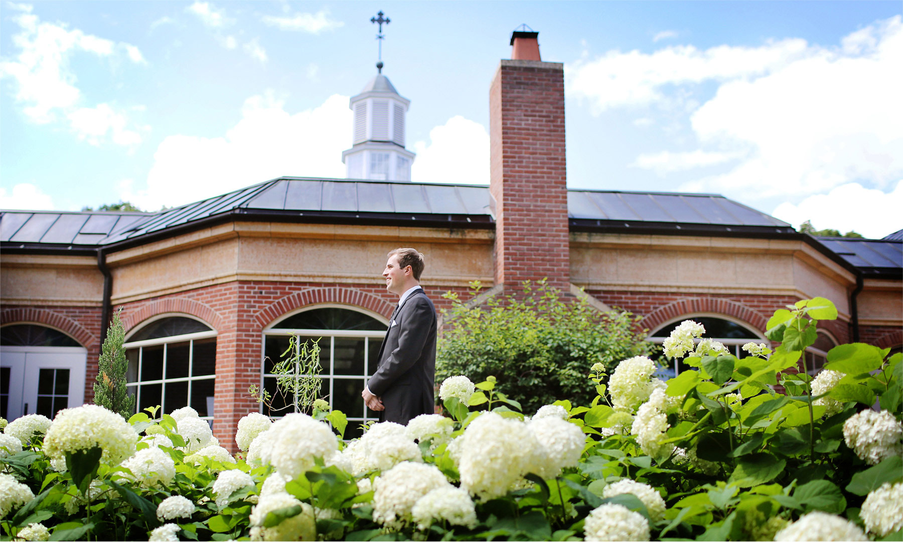 01-Edina-Minnesota-Wedding-Photographer-by-Andrew-Vick-Photography-Summer-Our-Lady-of-Grace-Catholic-Parish-Church-Groom-First-Look-Meeting-Betsy-and-Jon.jpg