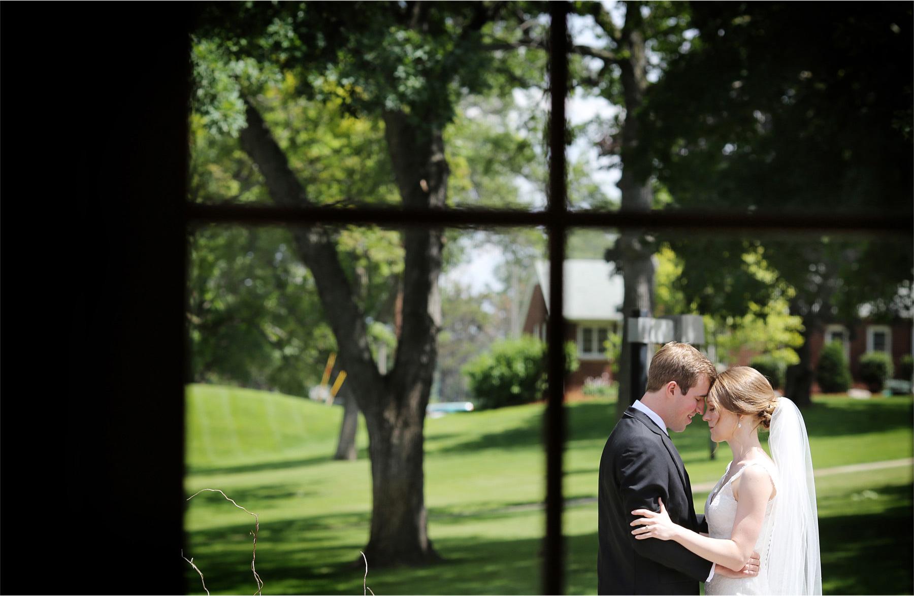 06-Edina-Minnesota-Wedding-Photographer-by-Andrew-Vick-Photography-Summer-Our-Lady-of-Grace-Catholic-Parish-Church-Bride-Groom-First-Look-Meeting-Window-Embrace-Betsy-and-Jon.jpg