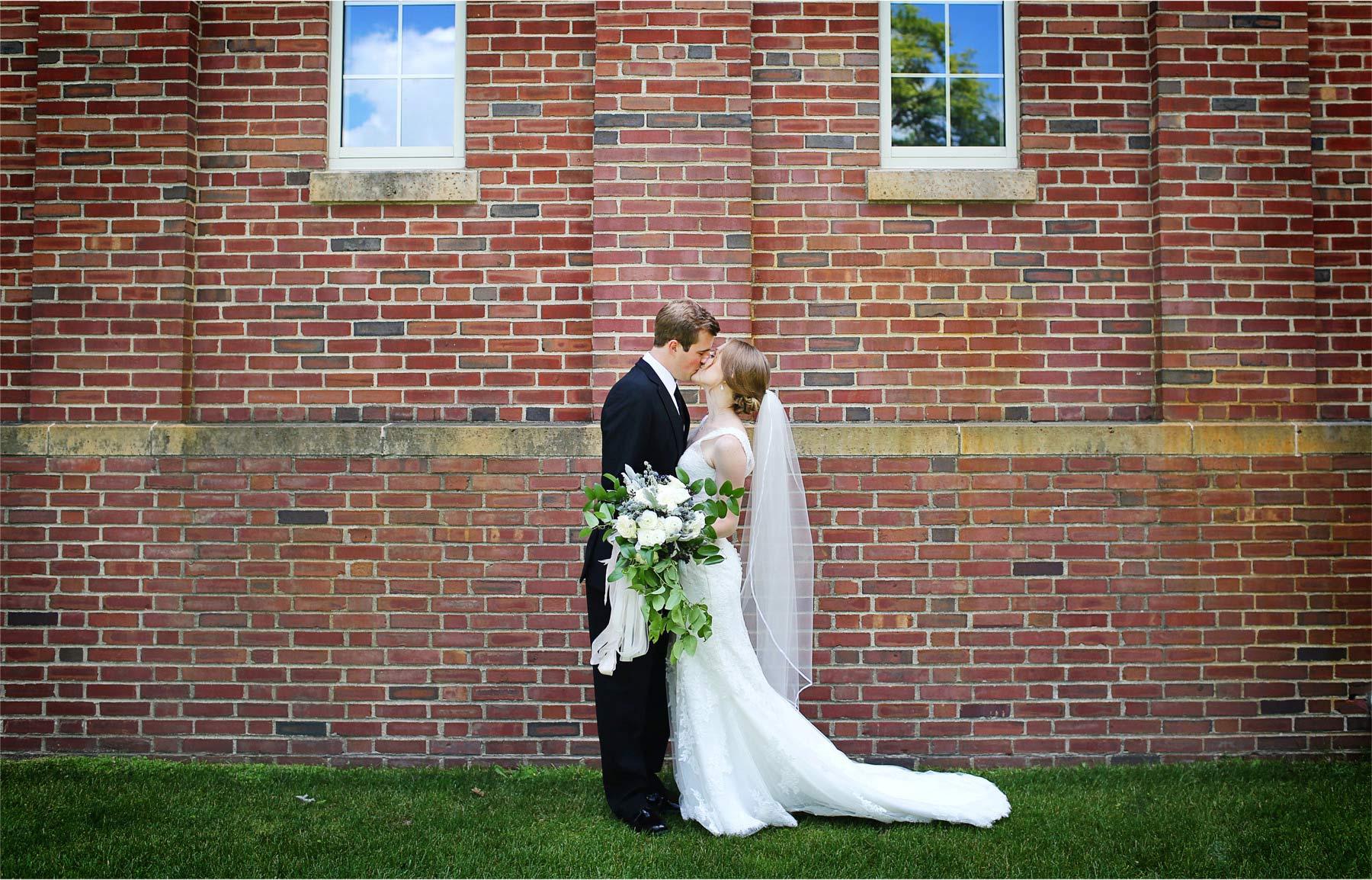 08-Edina-Minnesota-Wedding-Photographer-by-Andrew-Vick-Photography-Summer-Our-Lady-of-Grace-Catholic-Parish-Church-Bride-Groom-First-Look-Meeting-Kiss-Embrace-Betsy-and-Jon.jpg