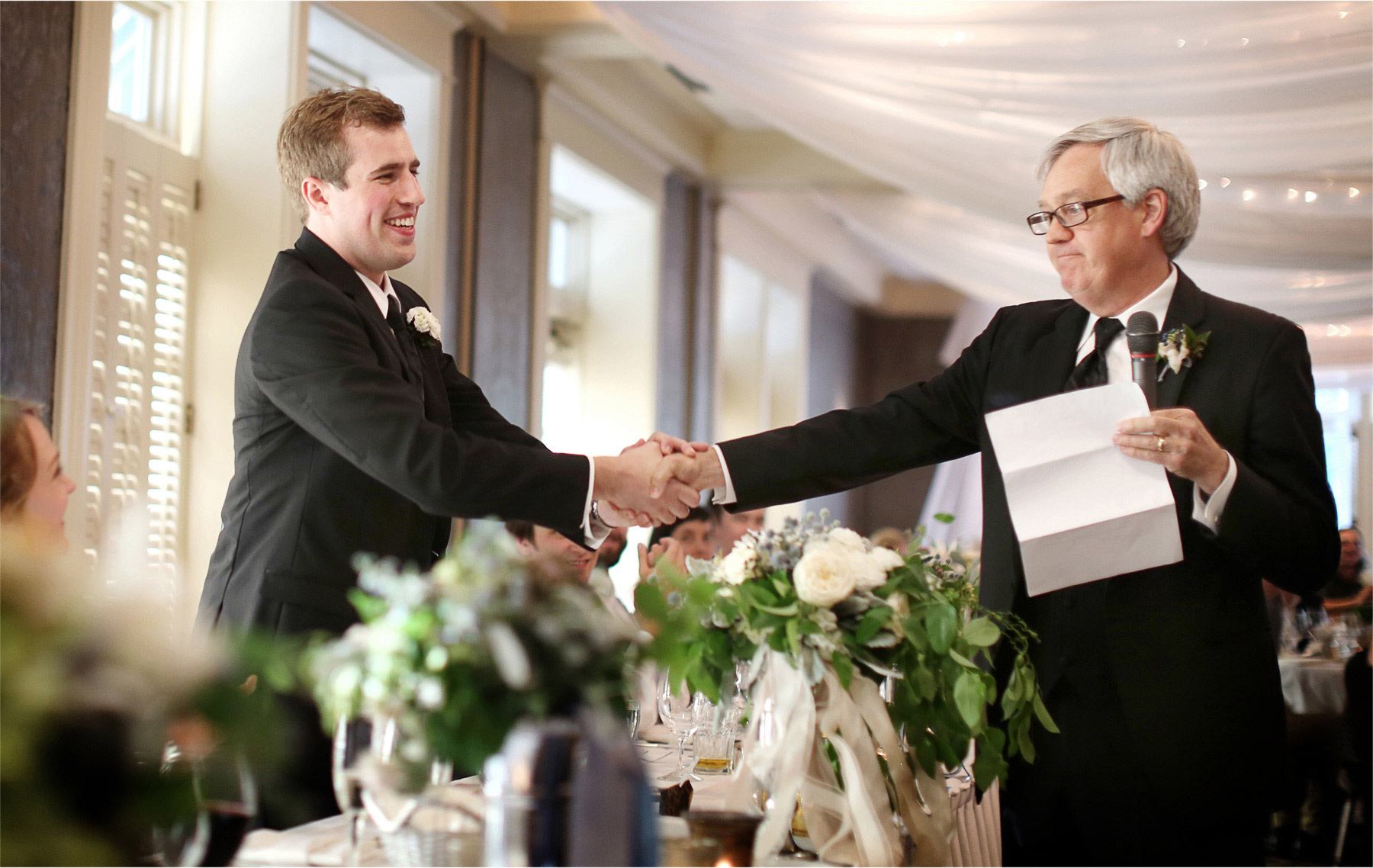 26-Edina-Minnesota-Wedding-Photographer-by-Andrew-Vick-Photography-Summer-Country-Club-Groom-Reception-Speeches-Toasts-Handshake-Betsy-and-Jon.jpg