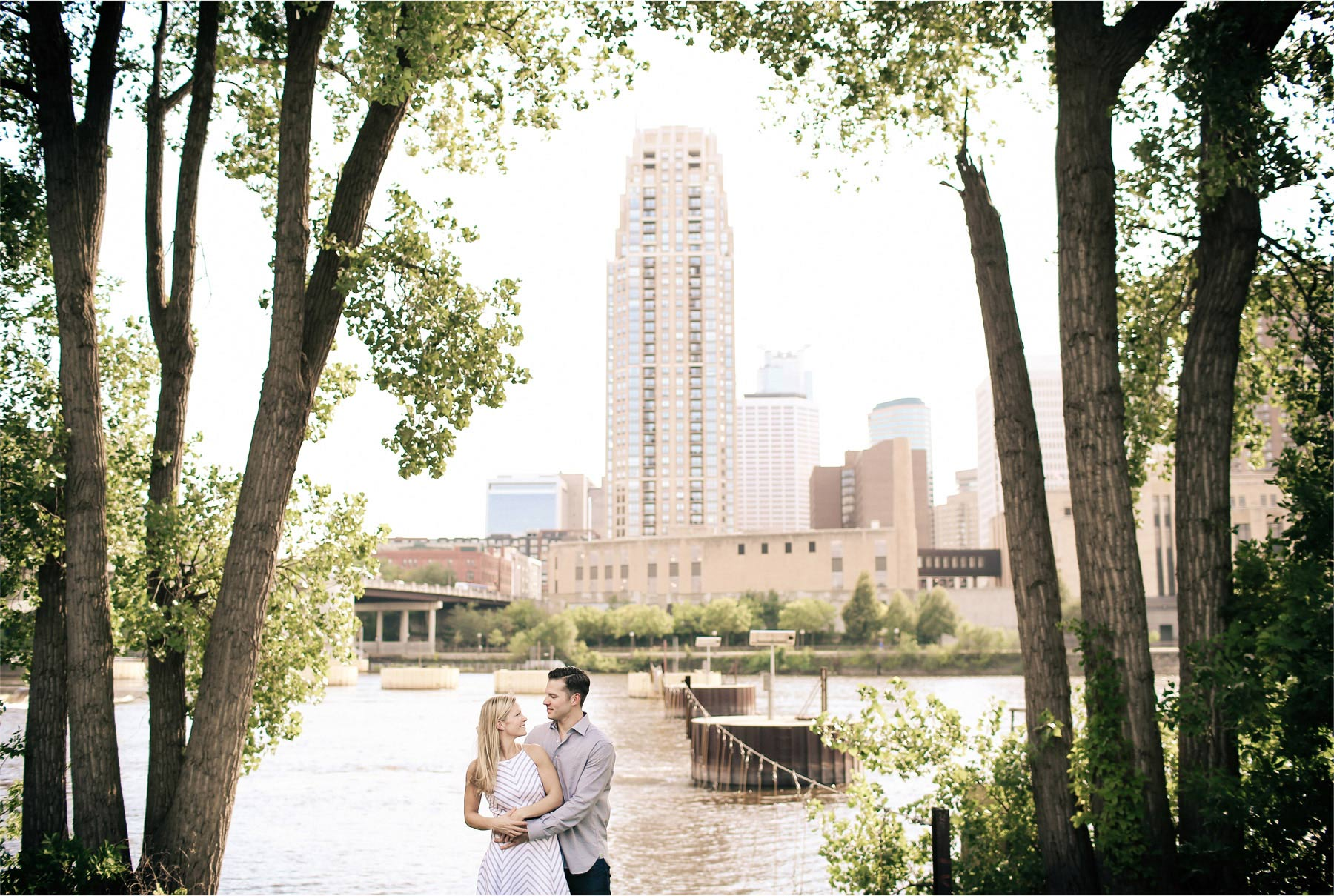 04-Minneapolis-Minnesota-Engagement-Photographer-by-Andrew-Vick-Photography-Summer-Mississippi-River-Embrace-Vintage-Tina-and-Kevin.jpg