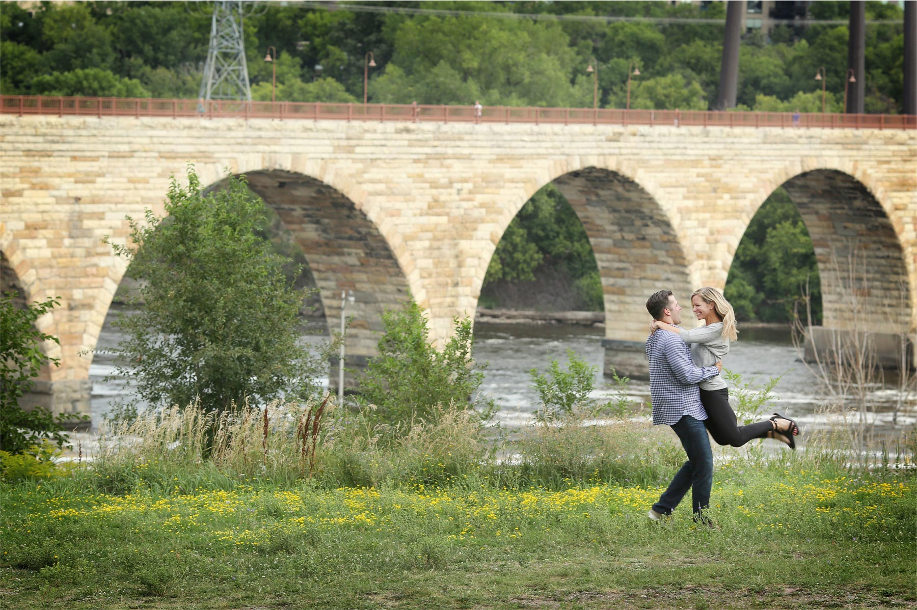 13-Minneapolis-Minnesota-Engagement-Photographer-by-Andrew-Vick-Photography-Summer-Mississippi-River-Stone-Arch-Bridge-Twirling-Tina-and-Kevin.jpg