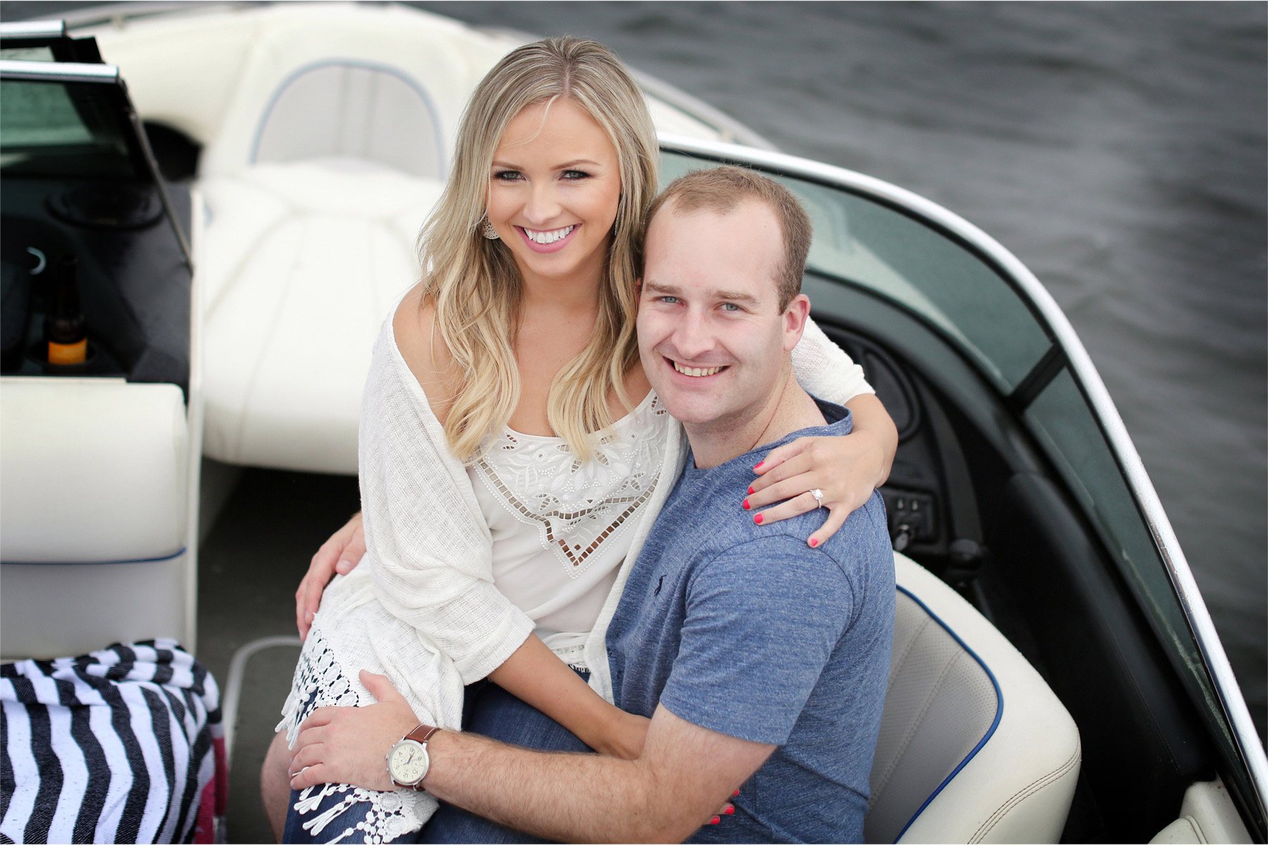 07-Wayzata-Minnesota-Engagement-Photographer-by-Andrew-Vick-Photography-Summer-Lake-Minnetonka-Embrace-Hug-Rain-Speed-Boat-Ashley-&-Kasey.jpg