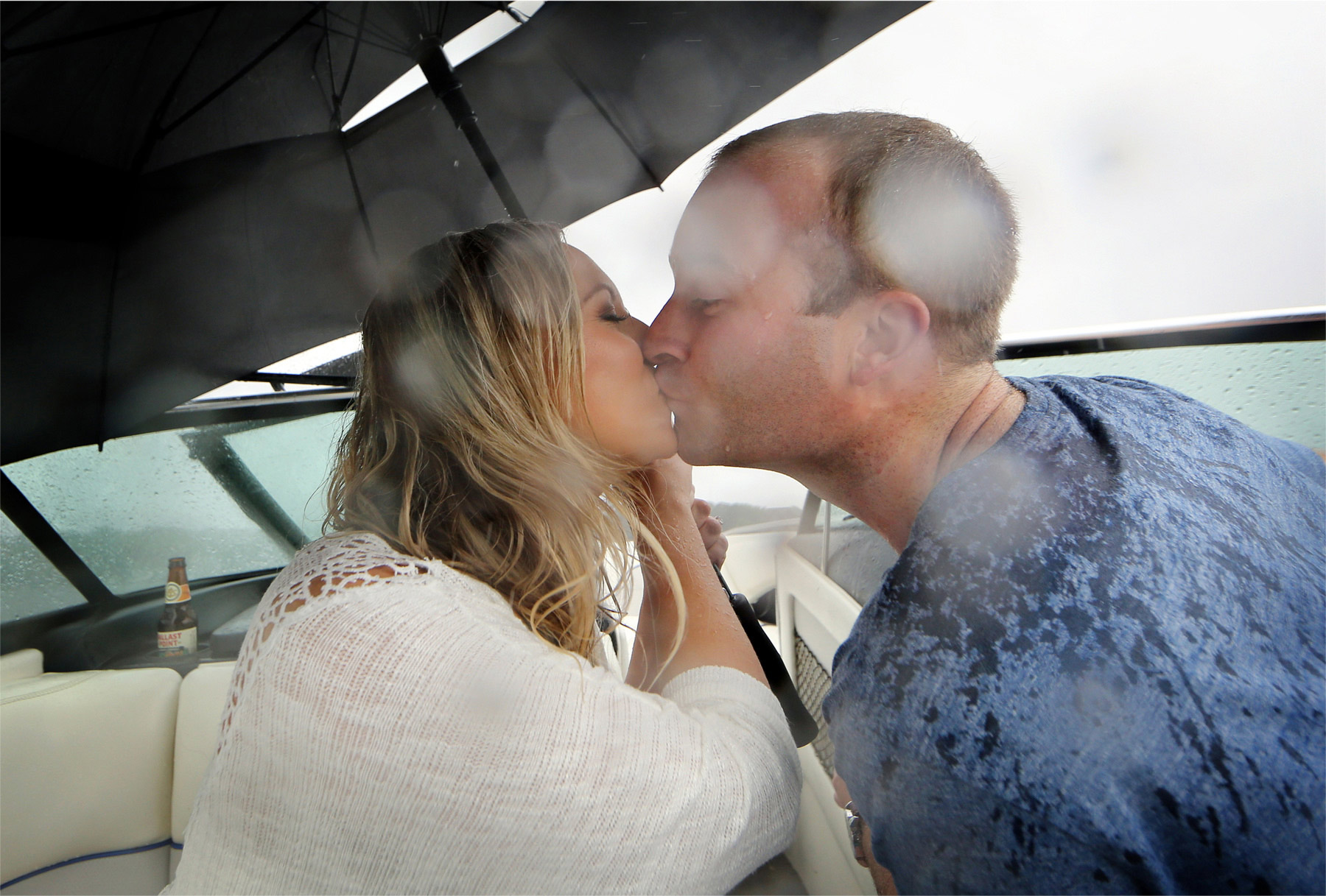 11-Wayzata-Minnesota-Engagement-Photographer-by-Andrew-Vick-Photography-Summer-Lake-Minnetonka-Umbrella-Rain-Kiss-Speed-Boat-Ashley-&-Kasey.jpg