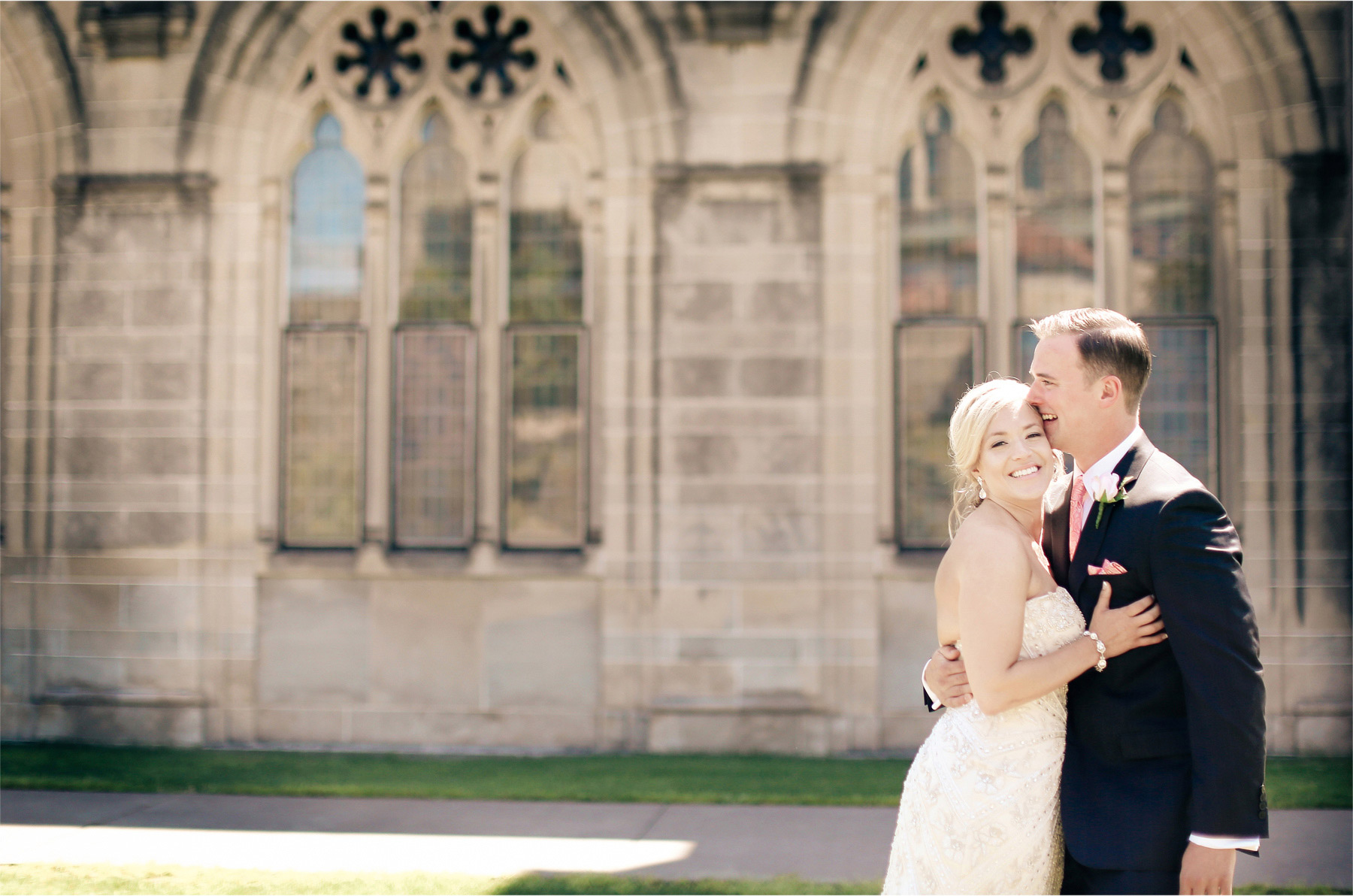 06-Duluth-Minnesota-Wedding-Photographer-by-Andrew-Vick-Photography-Summer-Cathedral-of-Our-Lady-of-the-Rosary-Church-First-Meeting-Bride-GroomCourtyard-Embrace-Vintage-Lindsey-and-Adam.jpg