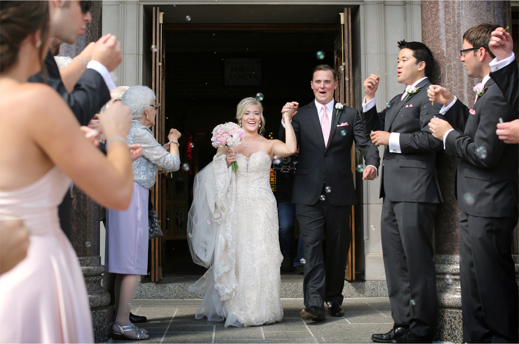 11-Duluth-Minnesota-Wedding-Photographer-by-Andrew-Vick-Photography-Summer-Cathedral-of-Our-Lady-of-the-Rosary-Church--Bride-Groom-Bubbles-Excitement-Lindsey-and-Adam.jpg