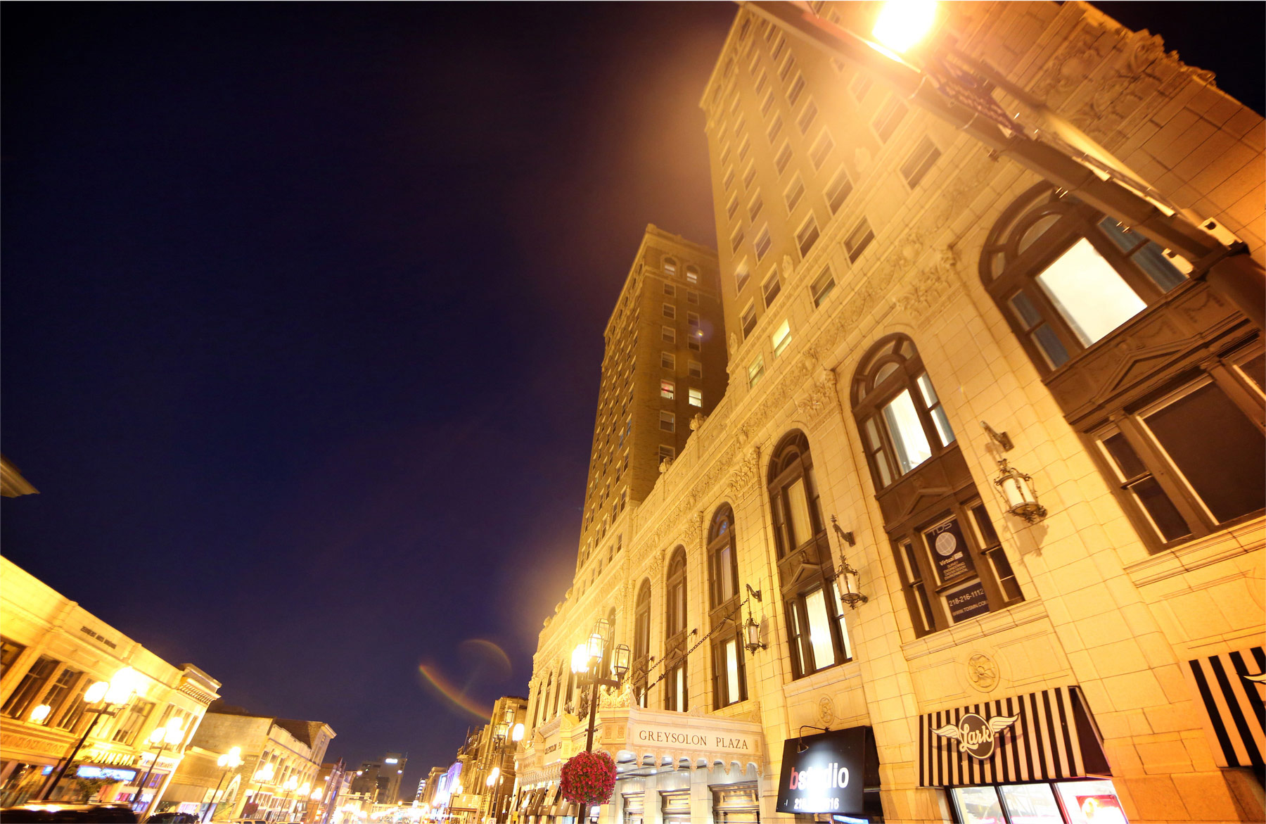 23-Duluth-Minnesota-Wedding-Photographer-by-Andrew-Vick-Photography-Summer-Greysolon-Ballroom-Outside-Street-View-Building-Night-Lindsey-and-Adam.jpg