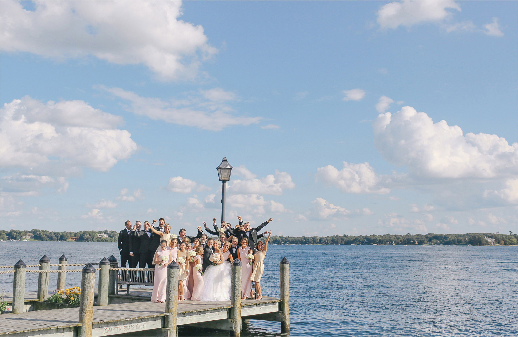 15-Minnetonka-Beach-Minnesota-Wedding-Photographer-by-Andrew-Vick-Photography-Summer-Lake-Bride-Groom-Bridal-Party-Excitement-Docks-Vintage-Emily-and-Jay.jpg