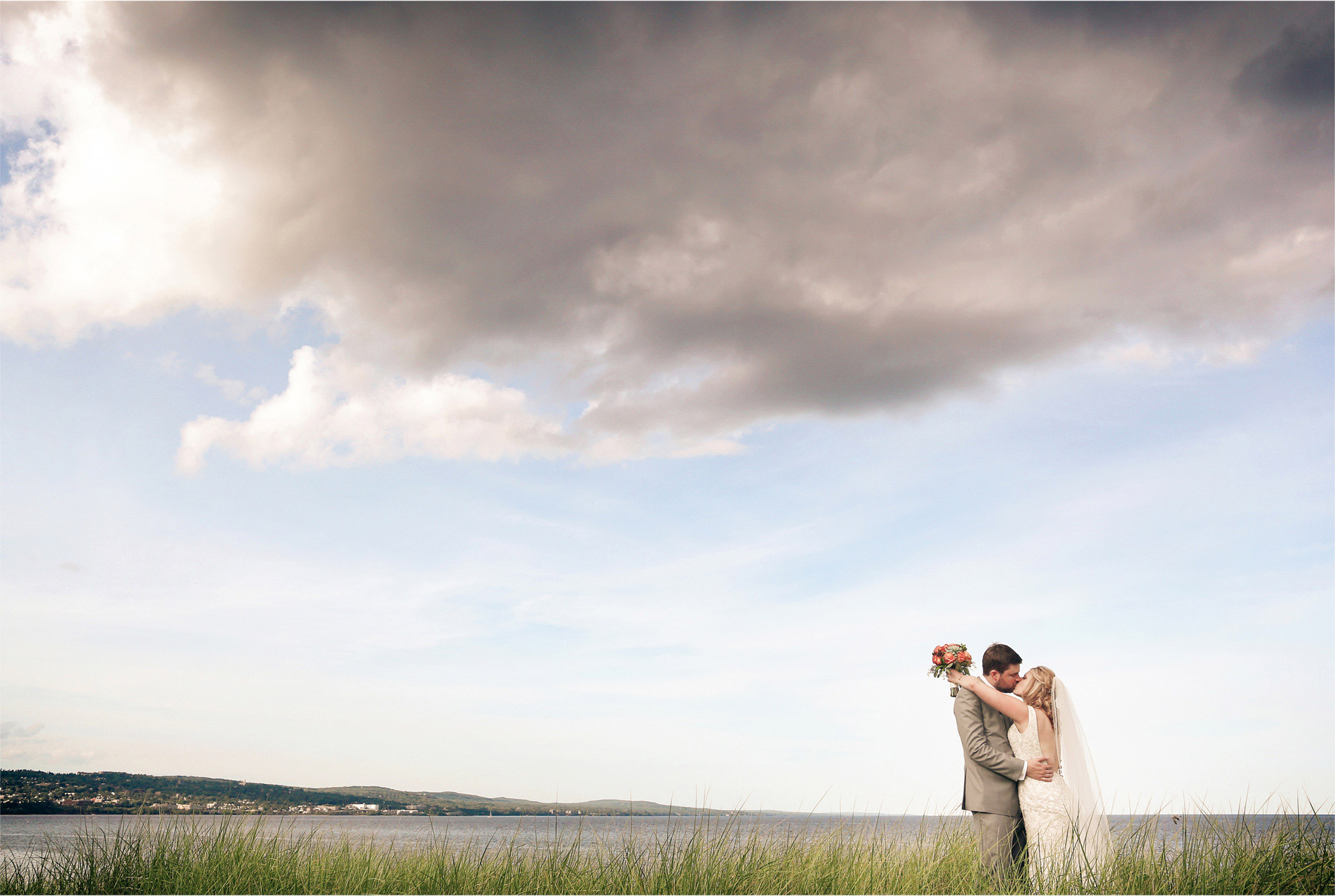 14-Duluth-Minnesota-Wedding-Photographer-by-Andrew-Vick-Photography-Summer-Bride-Groom-Lake-Superior-Grass-Kiss-Vintage-Katie-and-Andrew.jpg