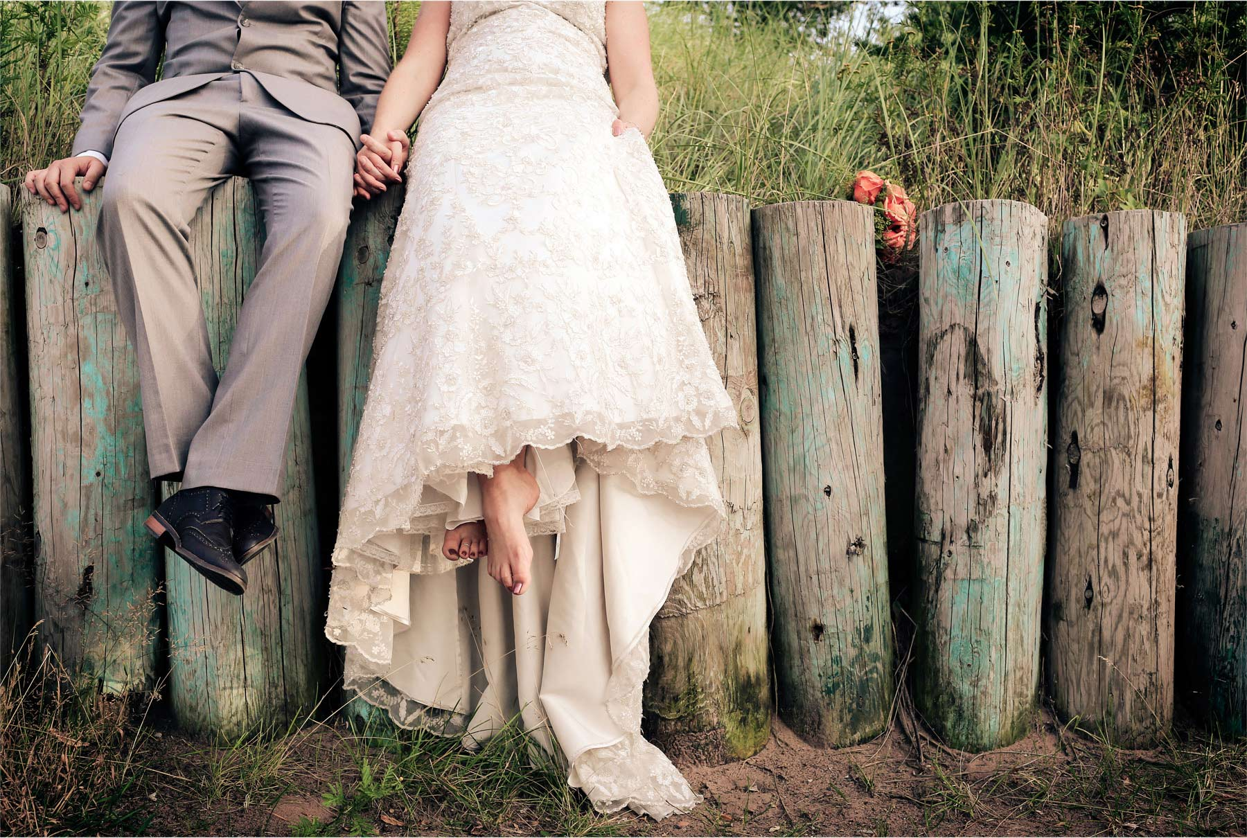 17-Duluth-Minnesota-Wedding-Photographer-by-Andrew-Vick-Photography-Summer-Bride-Groom-Holding-Hands-Sitting-Feet-Vintage-Katie-and-Andrew.jpg