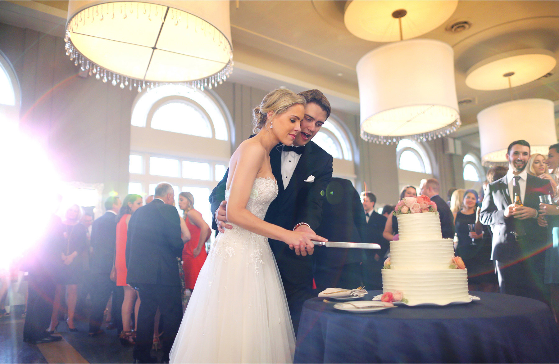 24-Minneapolis-Minnesota-Wedding-Photographer-by-Andrew-Vick-Photography-Summer--Calhoun-Beach-Club-Reception-Bride-Groom-Cake-Cutting-Guests-Michelle-and-Kevin.jpg